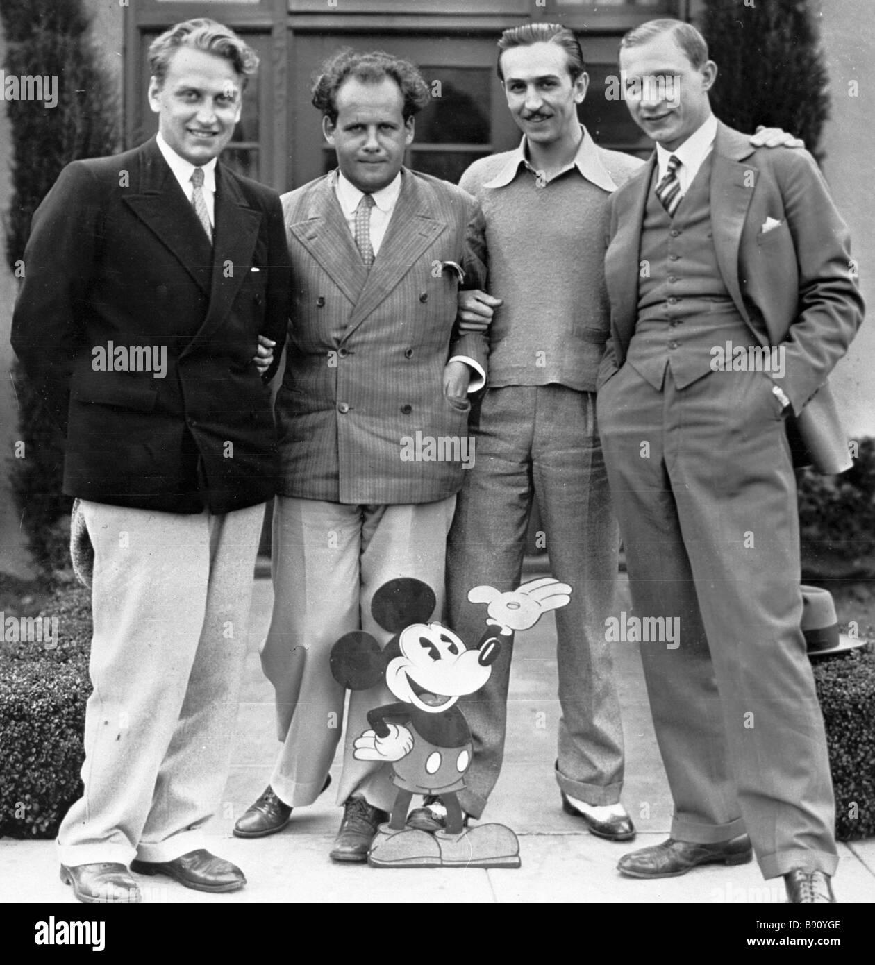 Left to right film directors Grigory Aleksandrov Sergei Eisenstein American director Walt Disney and Soviet camera - Stock Image