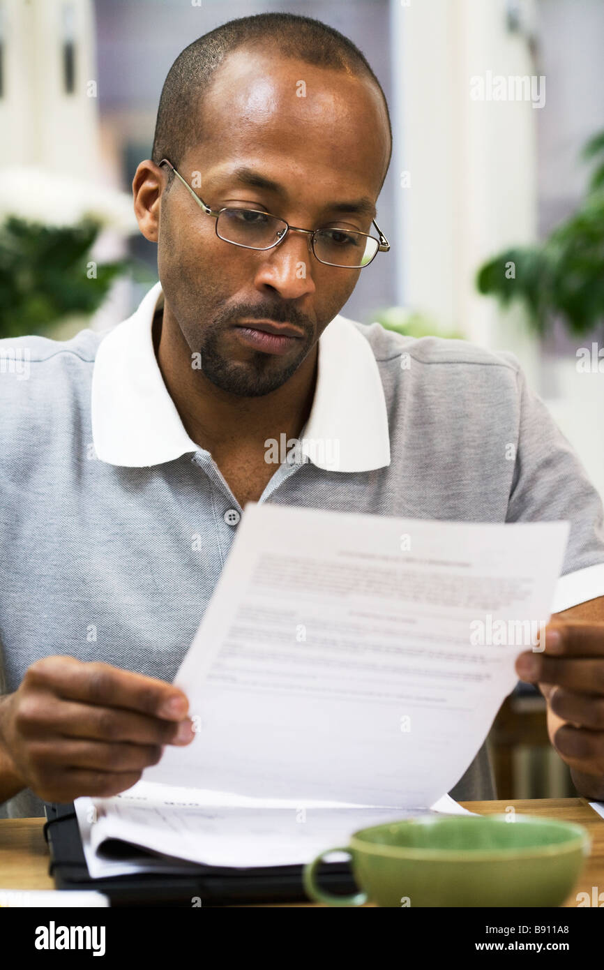 A man paying the bills Sweden. - Stock Image