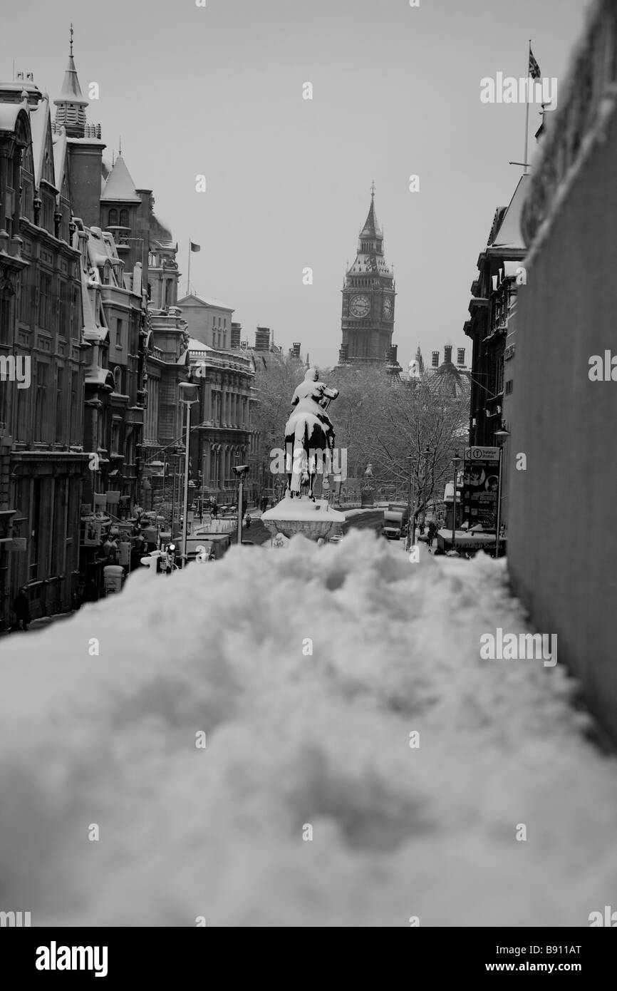 Snowy view from Trafalgar Square down Whitehall towards Big Ben, Houses of Parliament, London - Stock Image