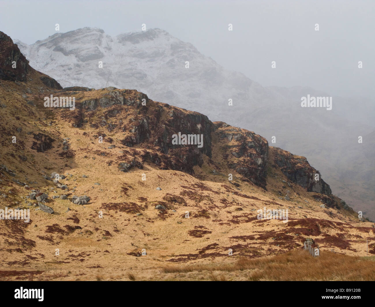 mist rolling over Scottish mountains in the highlands - Stock Image