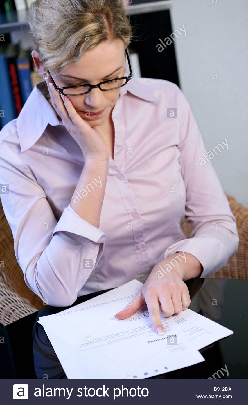 woman reading a letter getting bad news Stock Photo