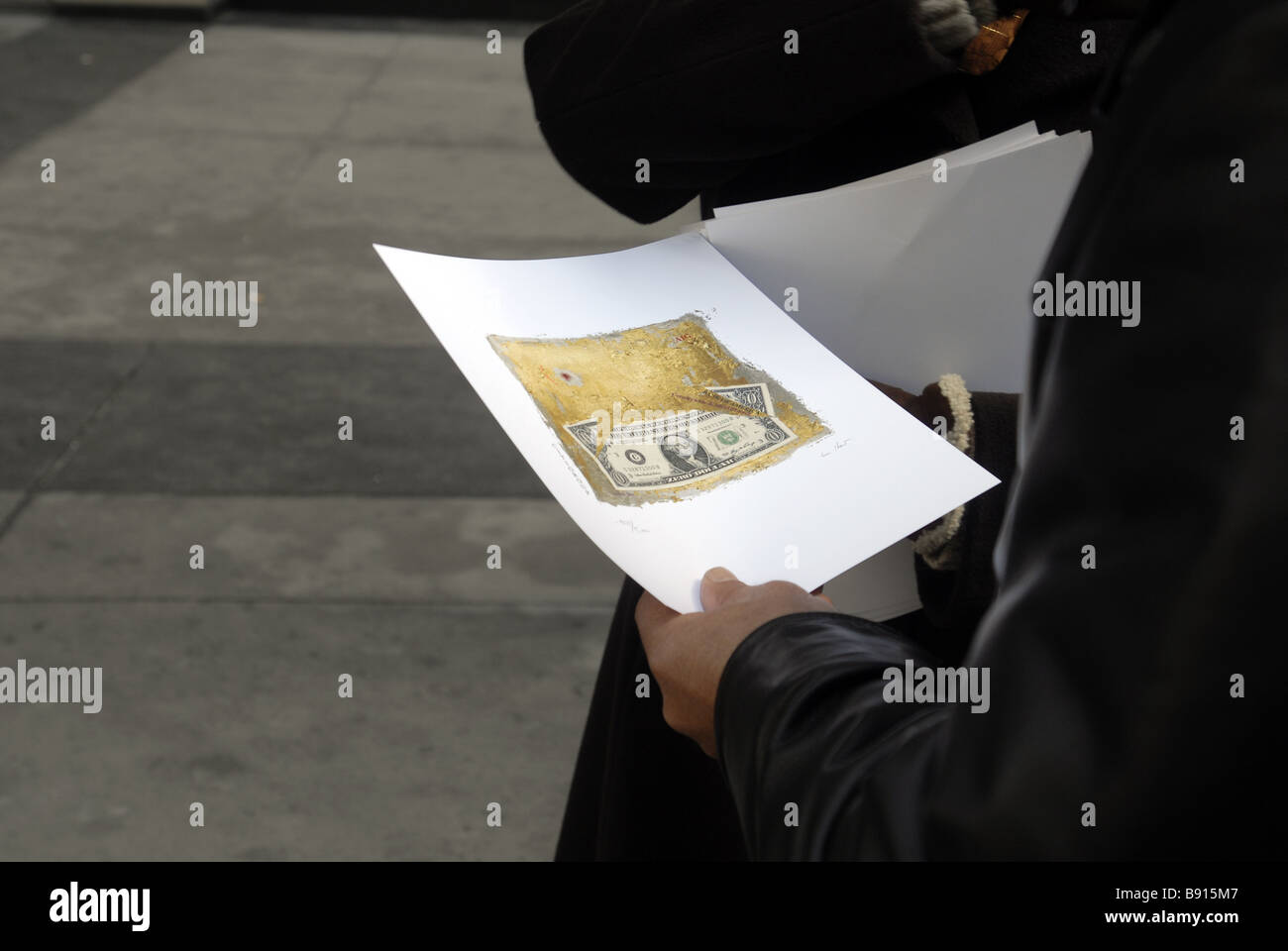The Laura Gilbert distributes signed and numbered original copies of her artwork The Bailout Bill in front of Citibank - Stock Image