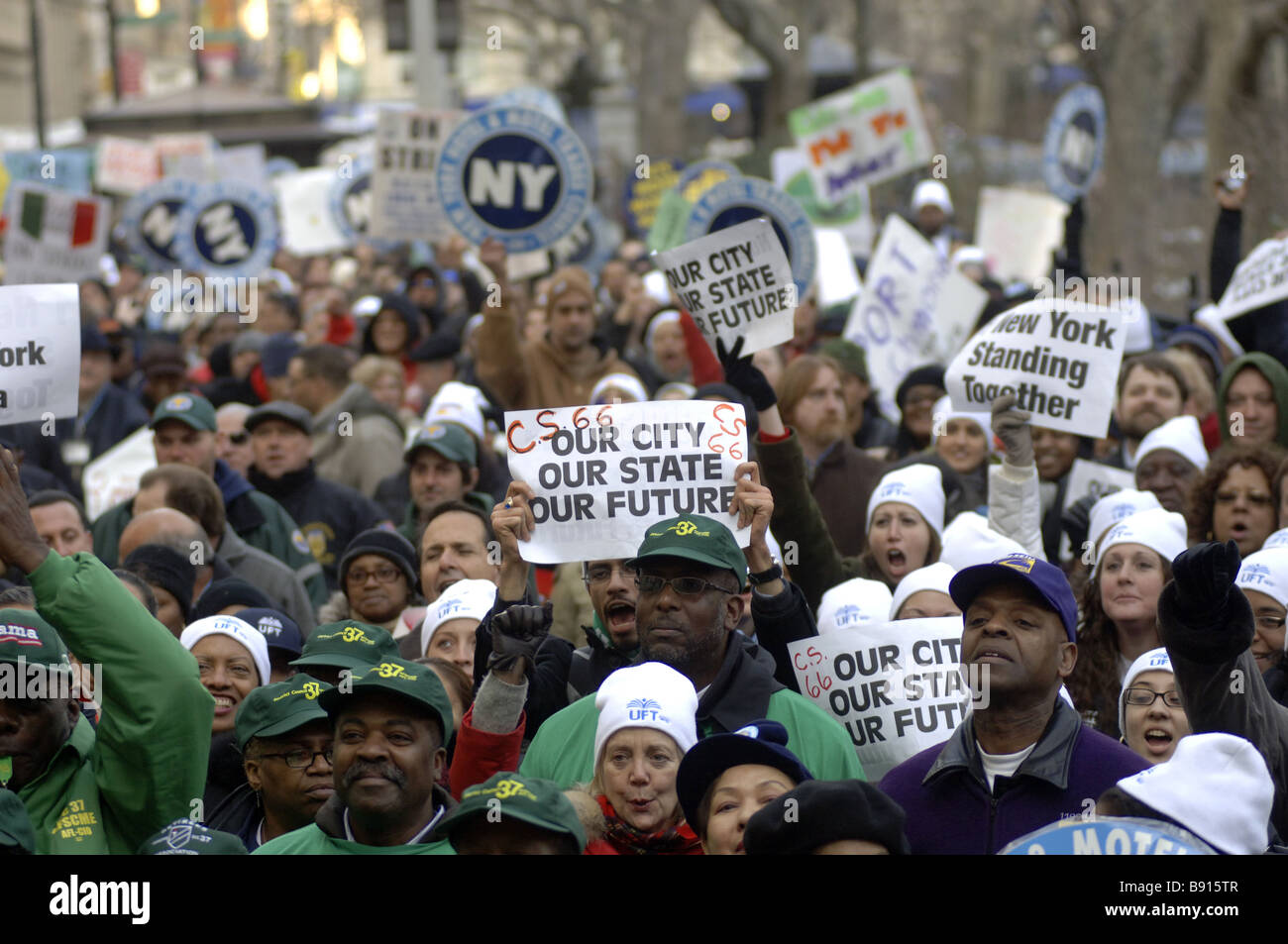 Thousands protest proposed state and city budget cuts outside City Hall in New York - Stock Image