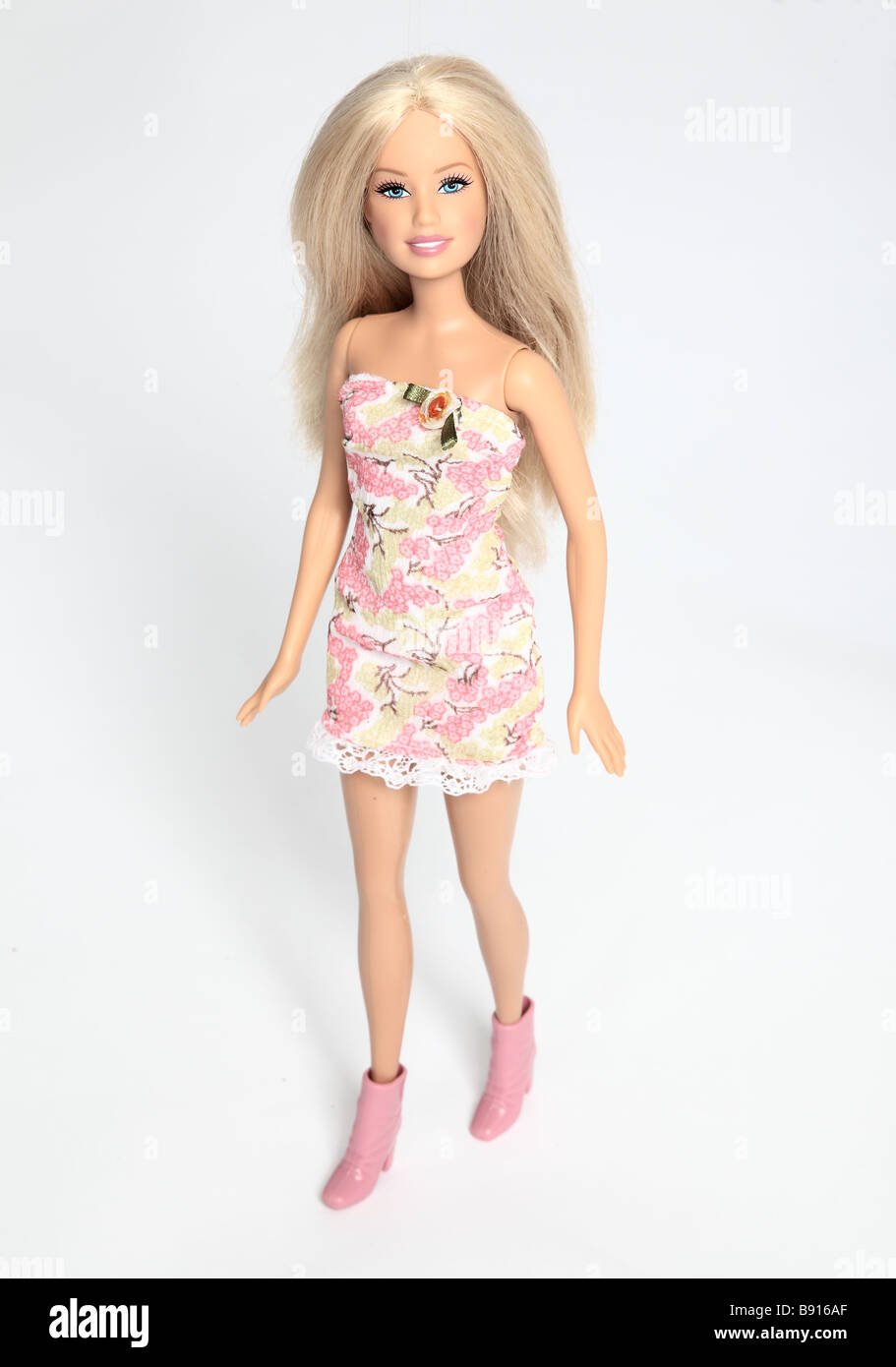 Barbie doll wearing a pink dress. - Stock Image
