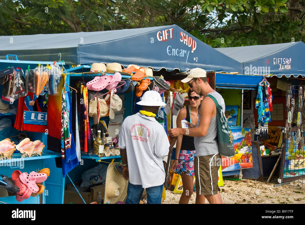 Tourist couple shopping for souvenirs in Bayahibe fishing village Dominican Republic southeast coast isla saona - Stock Image