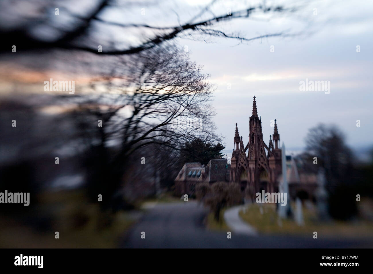 Creepy old church in a cemetery - Stock Image