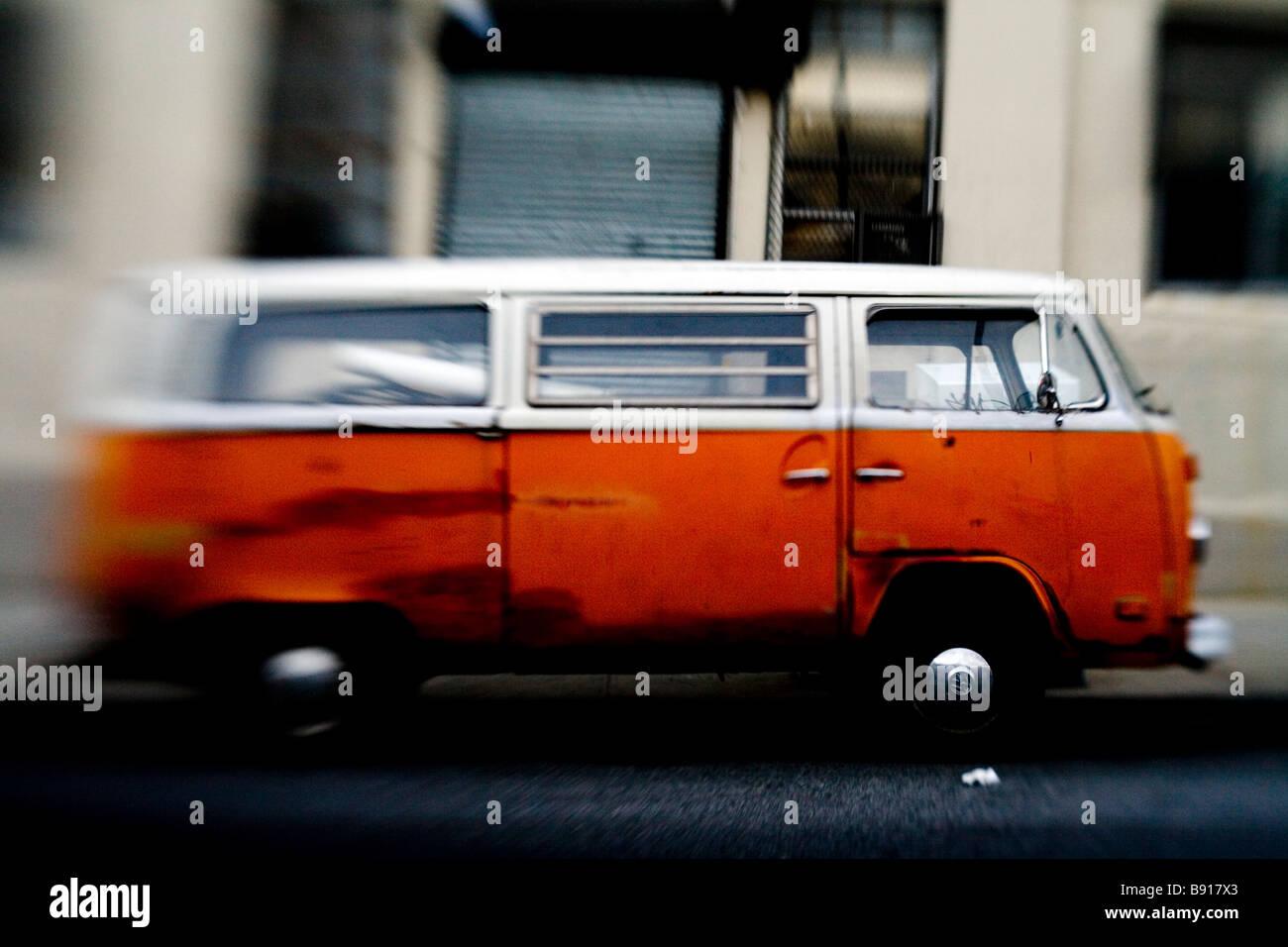 Lensbaby shot of an old orange VW Van - Stock Image