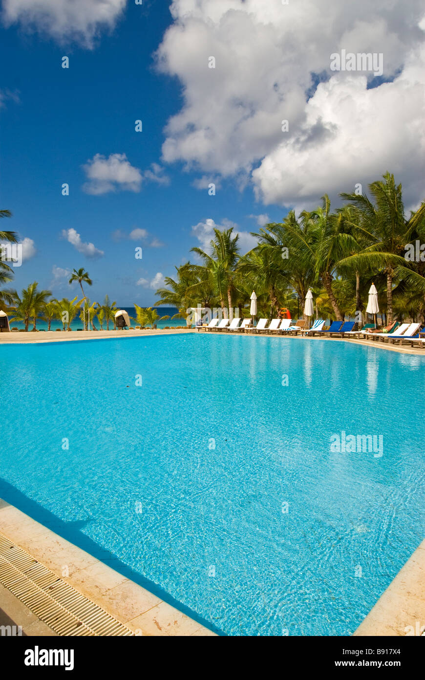 Deserted hotel swimming pool Bayahibe Dominican Republic Viva Wyndham Dominicus Palace all-inclusive resort with - Stock Image