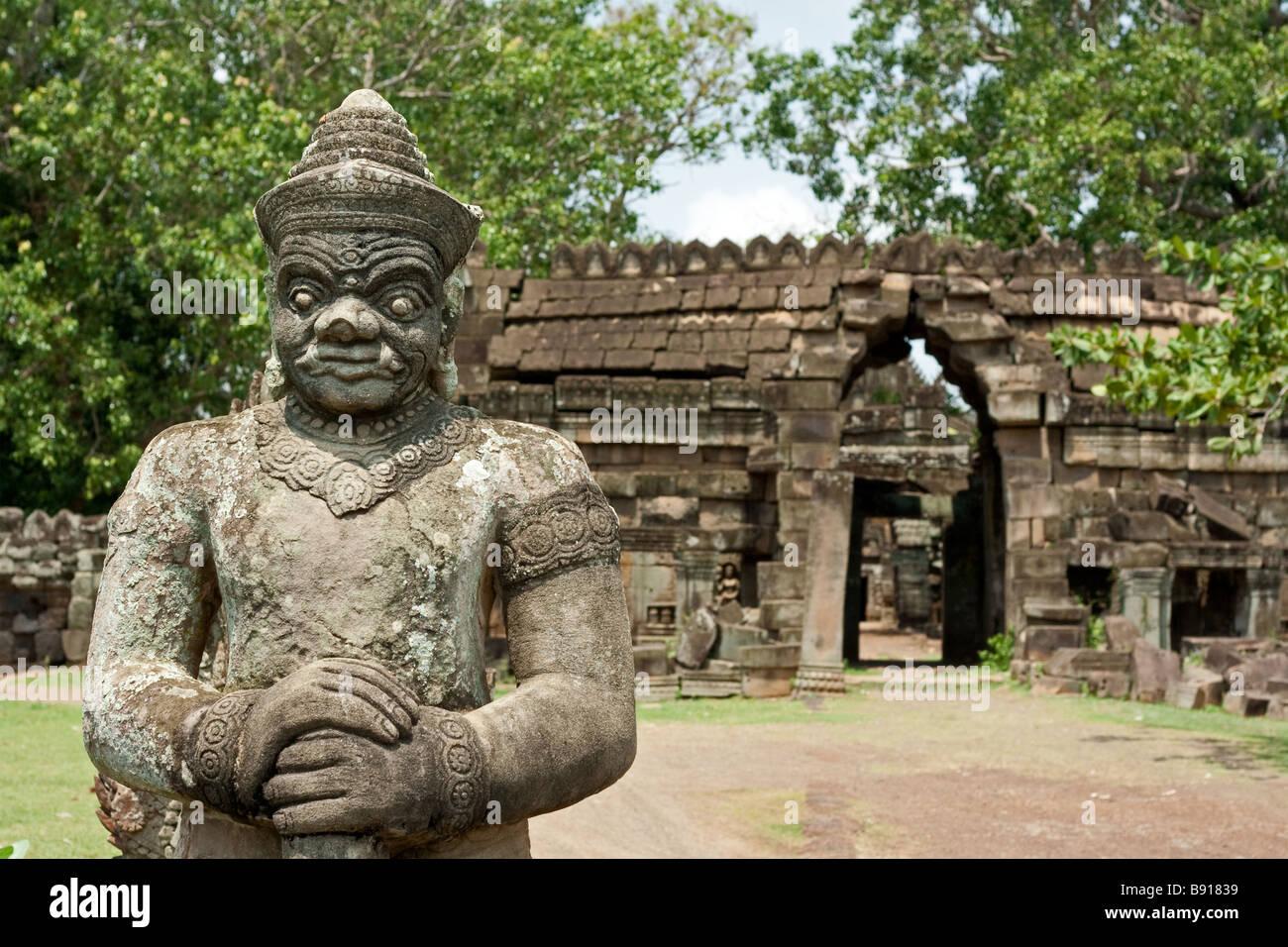 Angkorian stone statue at Wat Nok, Cambodia - Stock Image