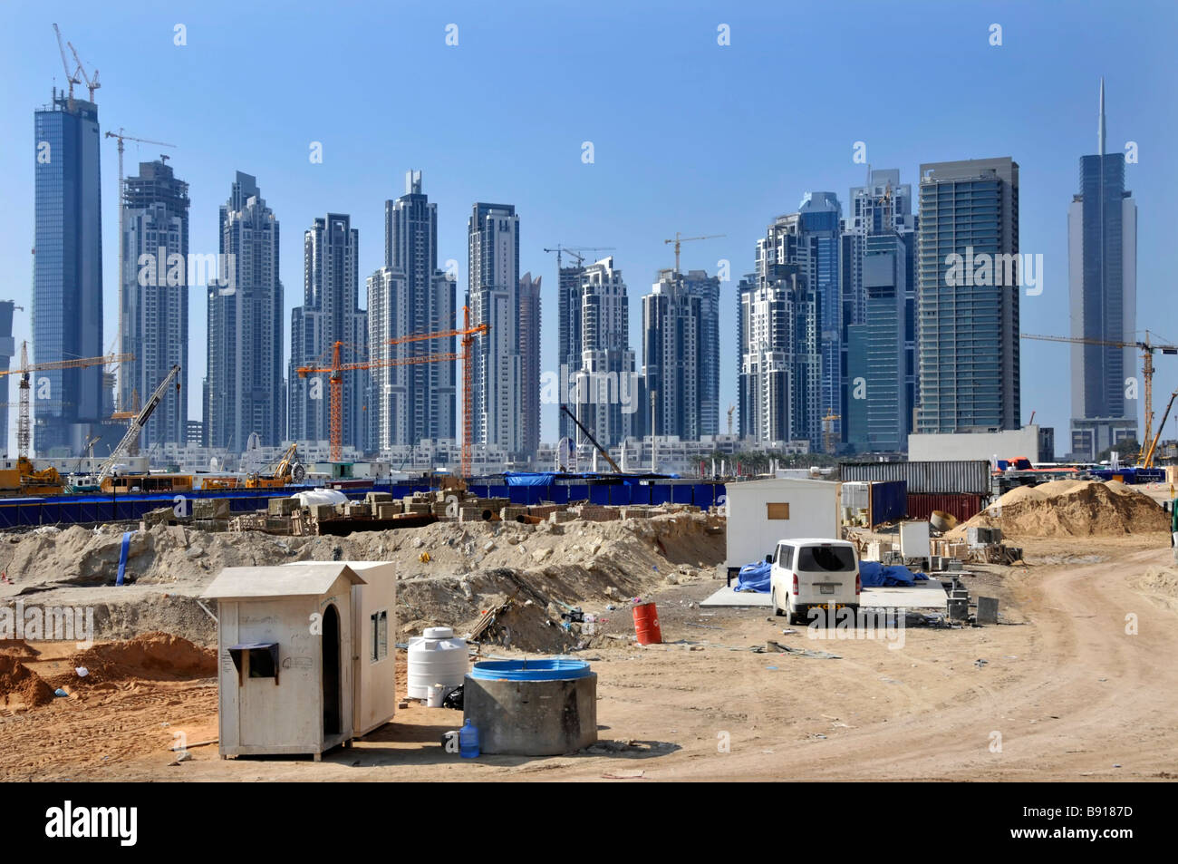 Dubai building site with high rise skyscrapers under construction - Stock Image