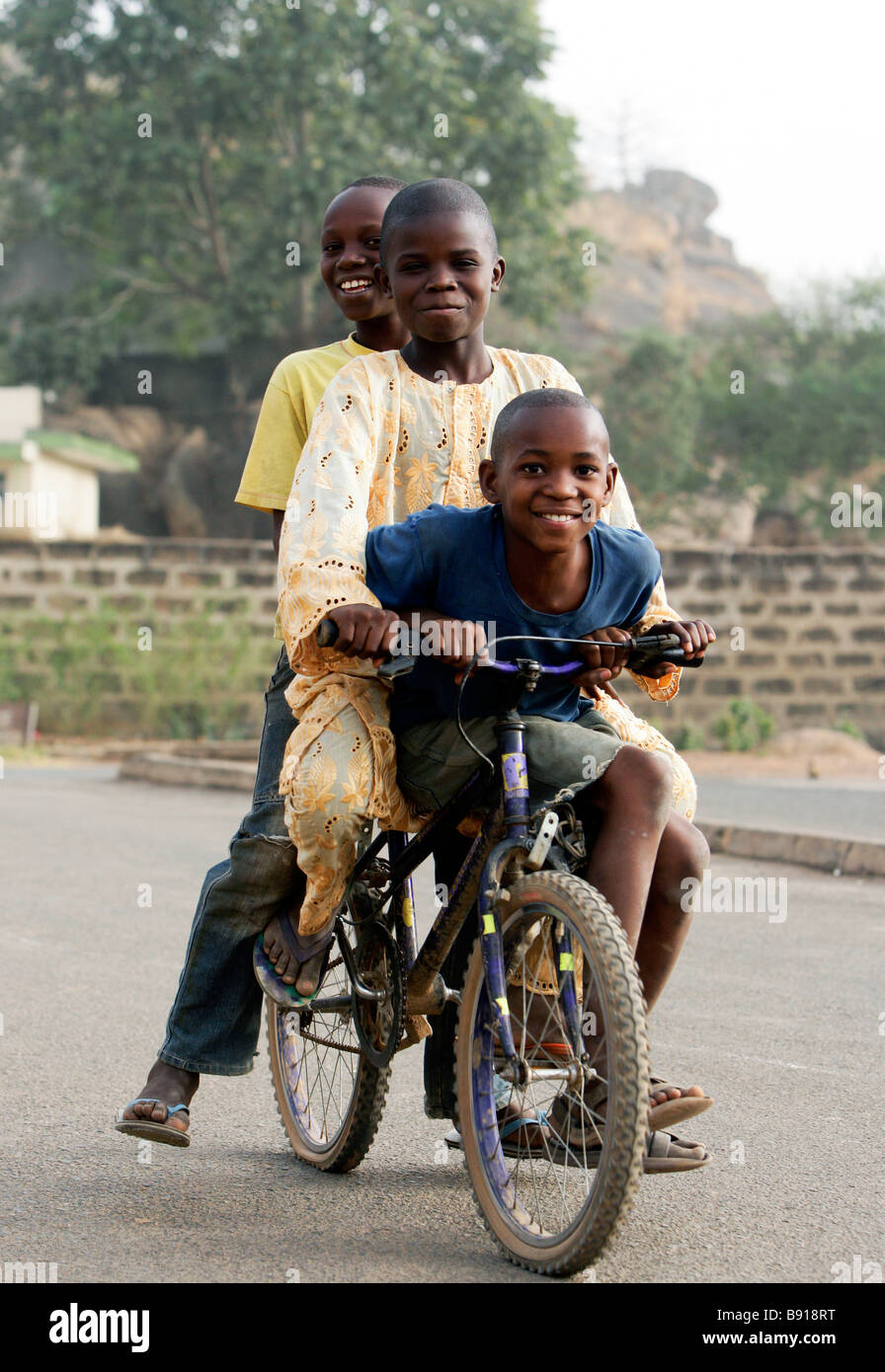 Three boys on a bicycle - Stock Image