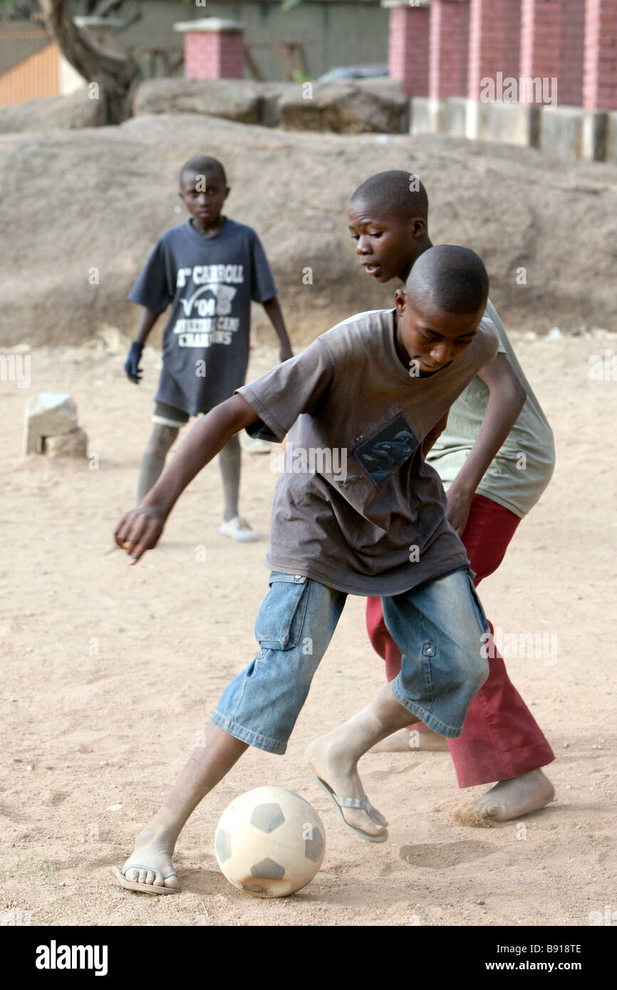 Nigeria: young boys play football, soccer - Stock Image