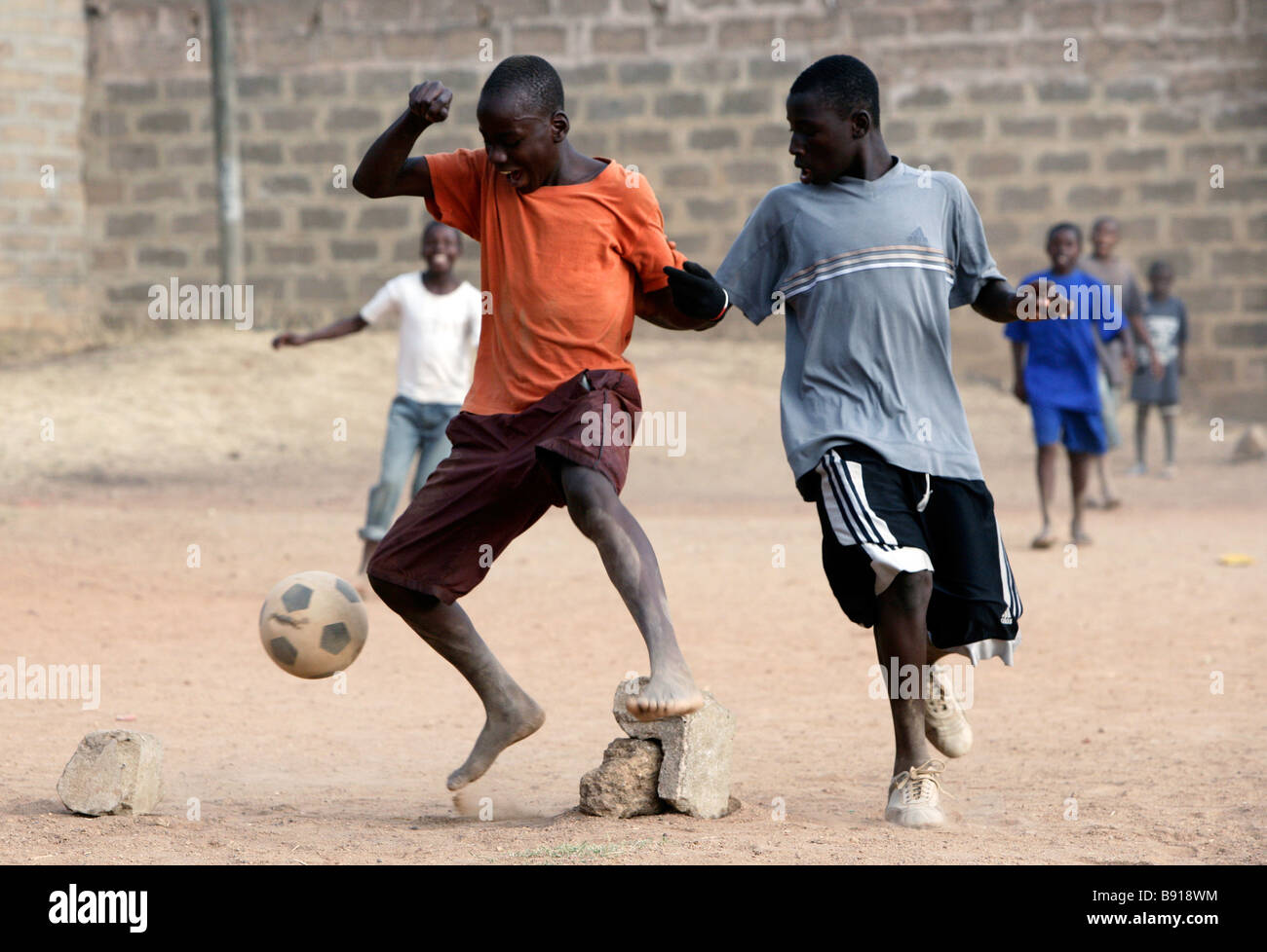 Nigeria: young boys play football, soccer - Stock Image