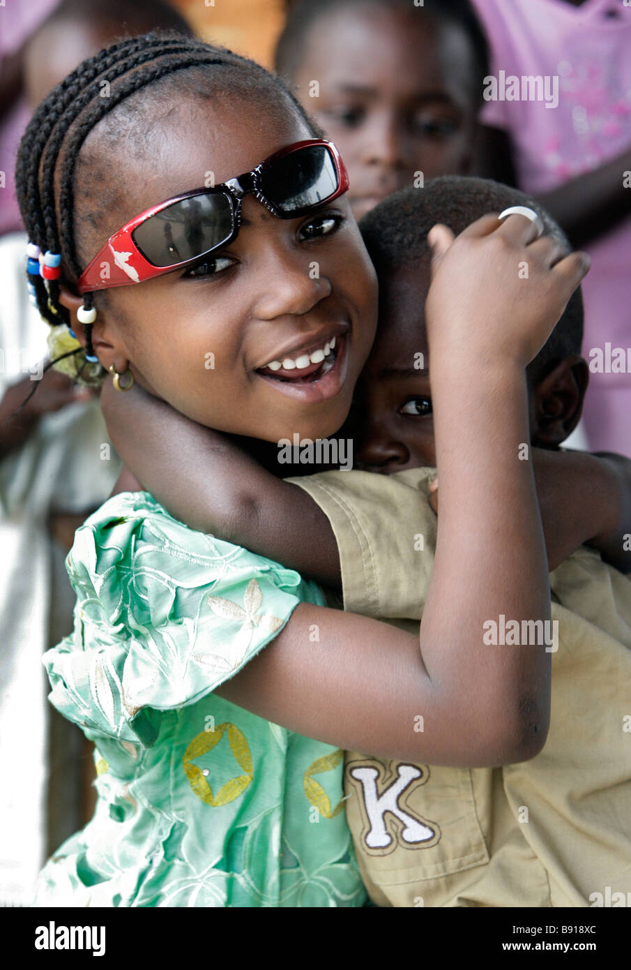 Nigeria: girl protects her younger brother - Stock Image