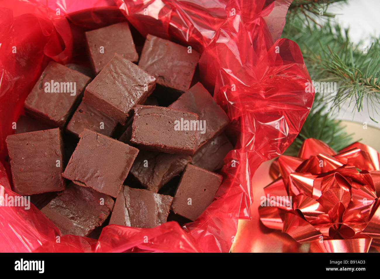 a closeup of homemade fudge in a holiday tin for gift giving Stock Photo