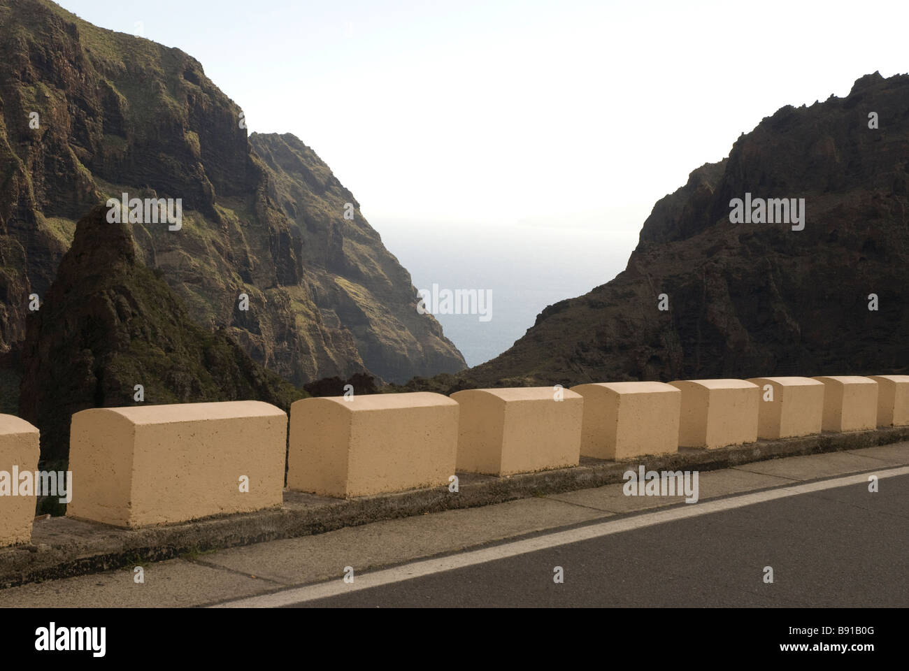 A road with stone blocks for protection on a small curvy road in the north of Tenerife (Canary Islands, Spain) Stock Photo