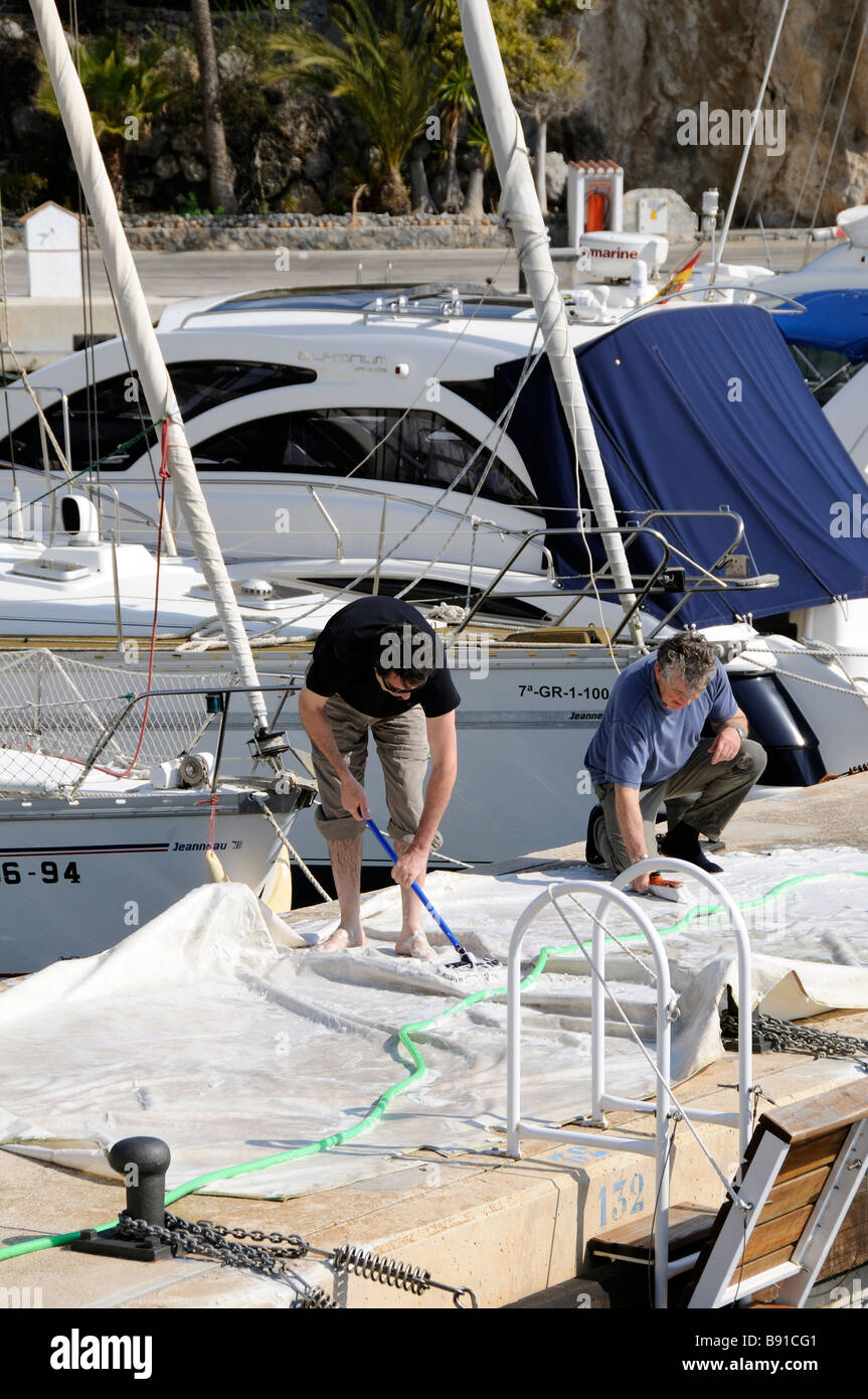 Marina del Este on the Costa Tropical Andalucia southern Spain Leisure boats cleaning sails on the boardwalk - Stock Image