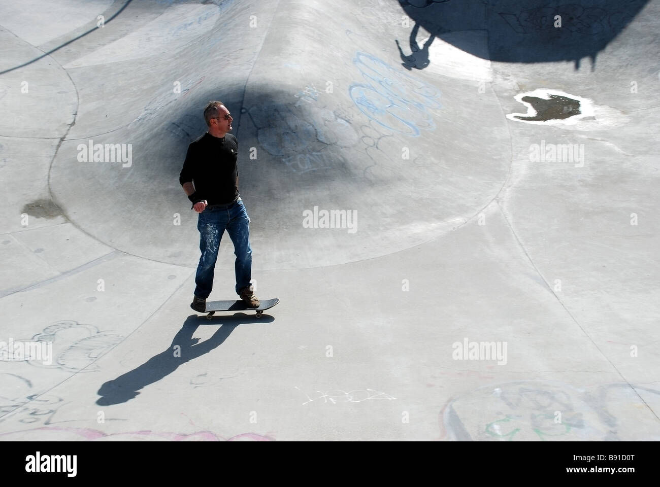 Skateboarder at Brixton playground - Stock Image