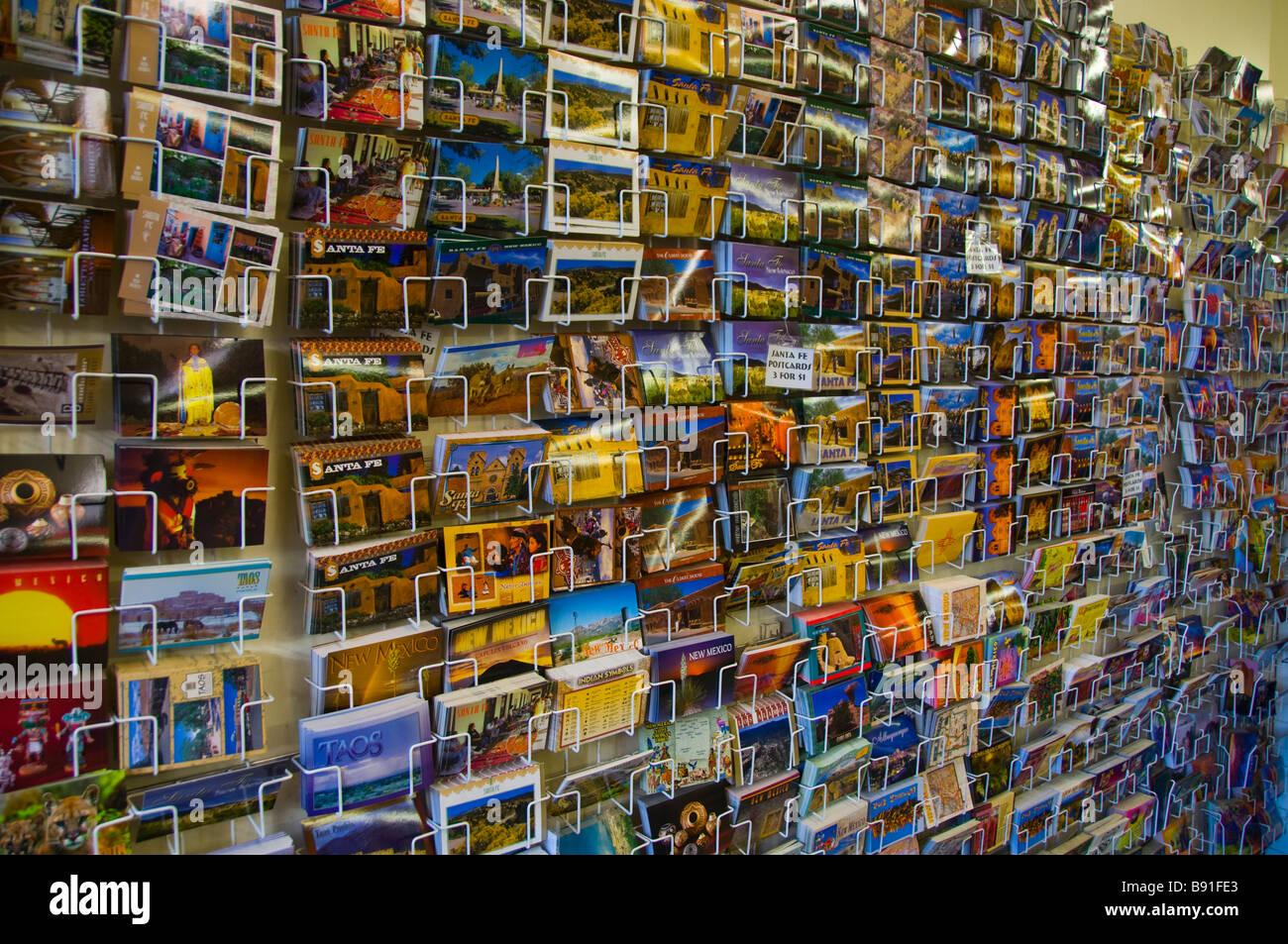 Wall display of travel postcards - Stock Image
