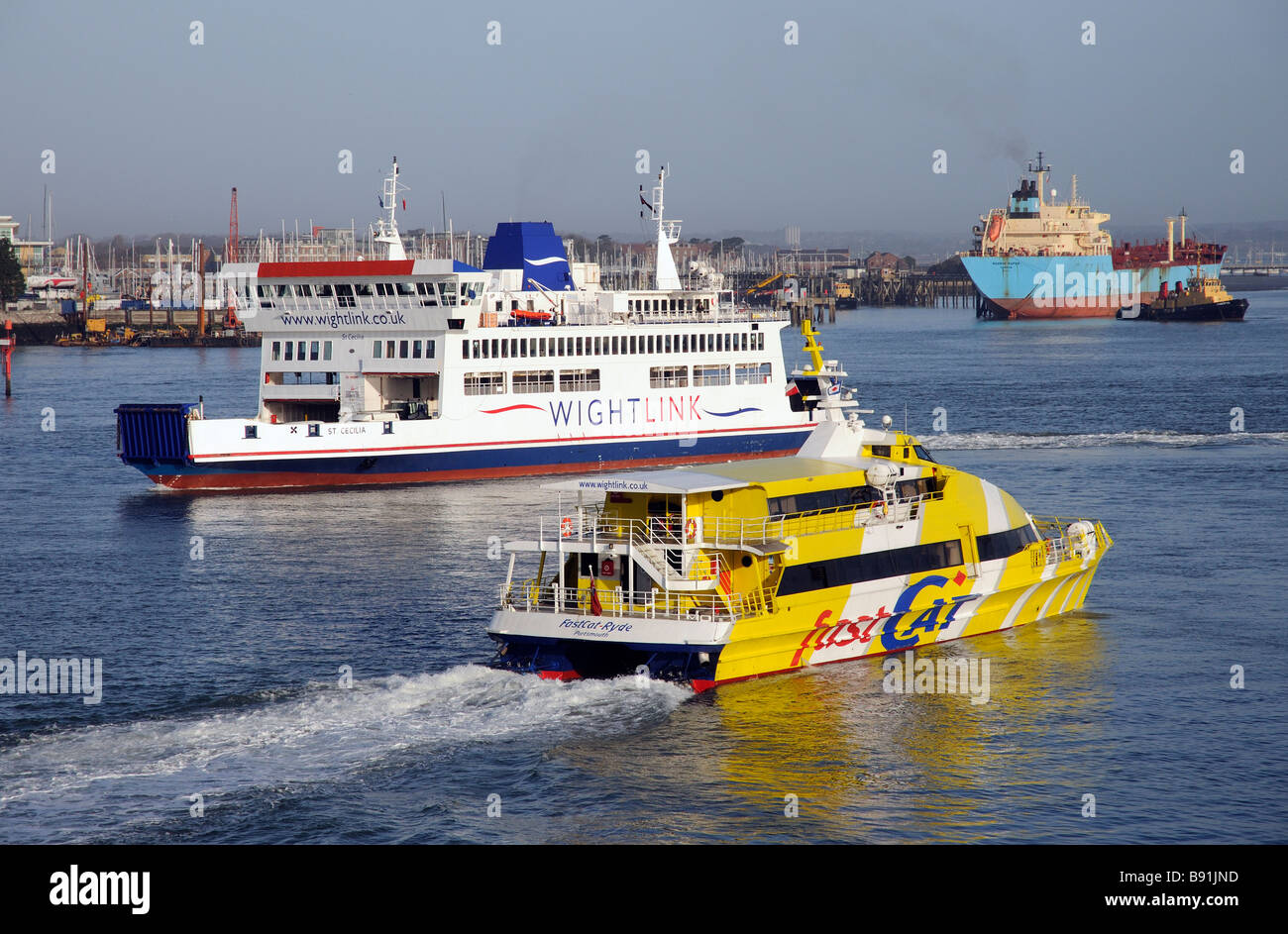 Portsmouth Harbour busy with shipping St Cecilia a roro ferry and seacat ryde a passenger ferry both operate to - Stock Image