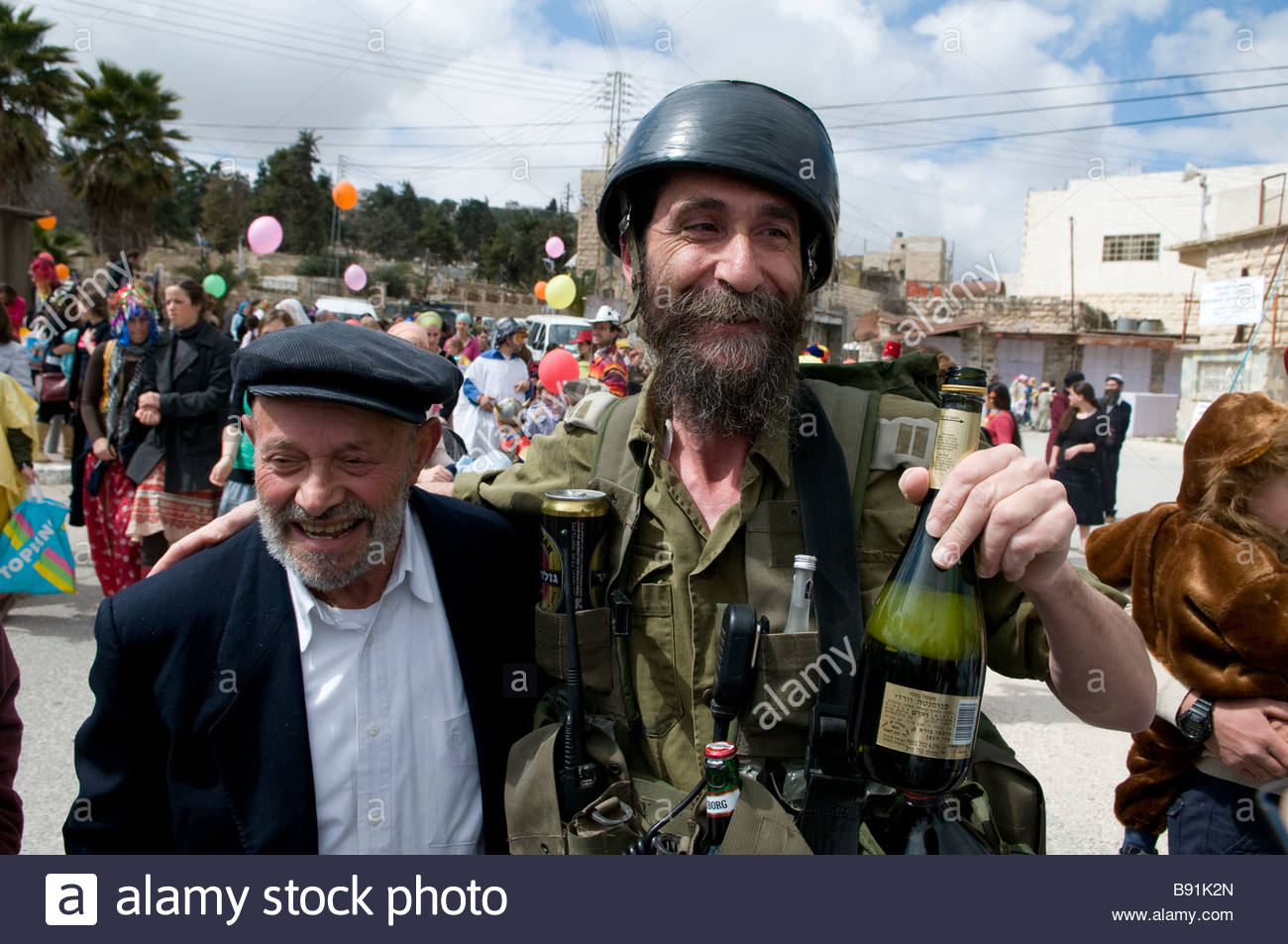 Right wing Jewish settler wearing military uniform costume during Purim holiday in the divided town of Hebron Israel - Stock Image