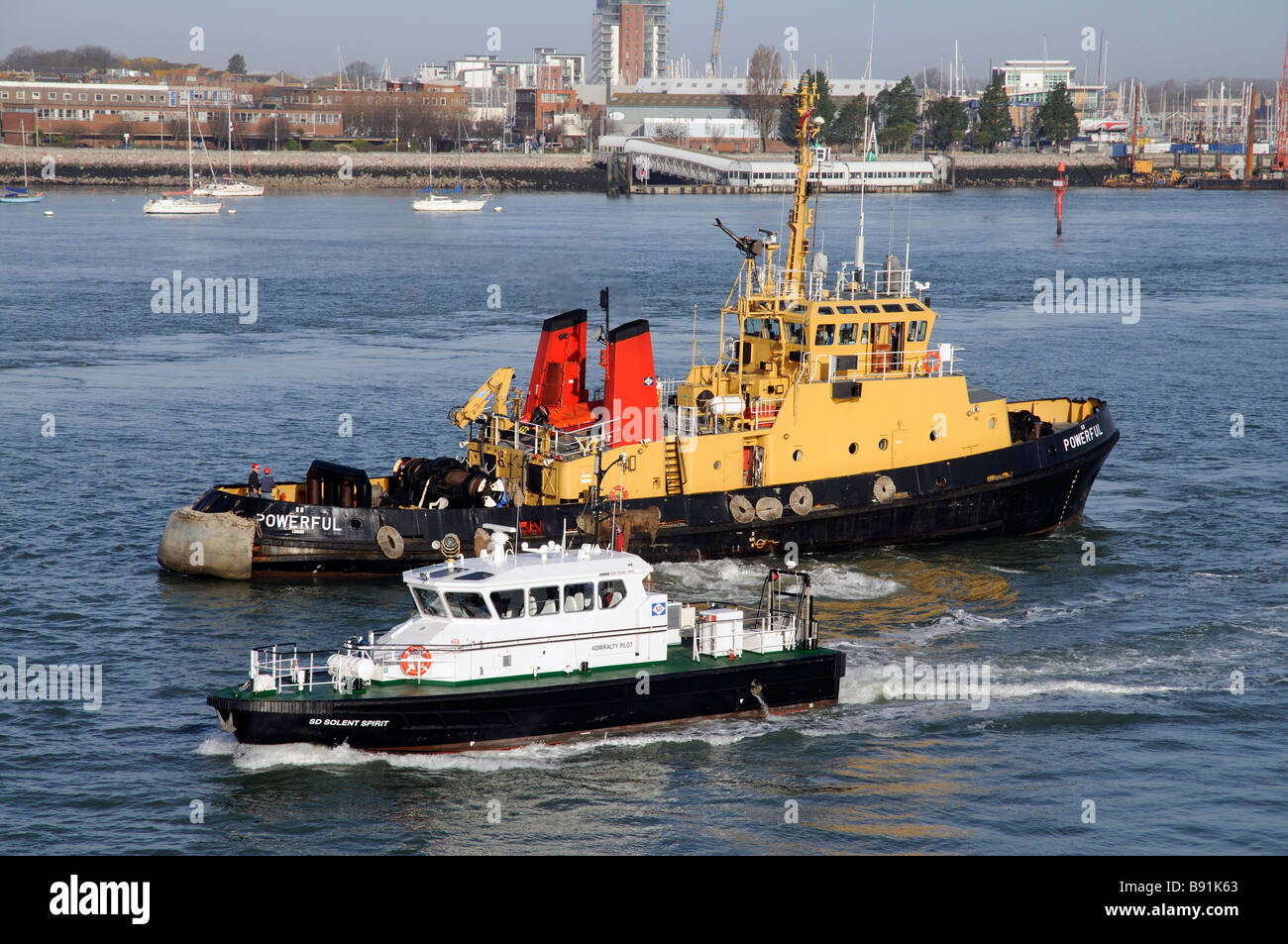 Serco Denholm SD operated vessels on Portsmouth Harbour southern England UK Tug Powerful and SD Solen Spirit an - Stock Image