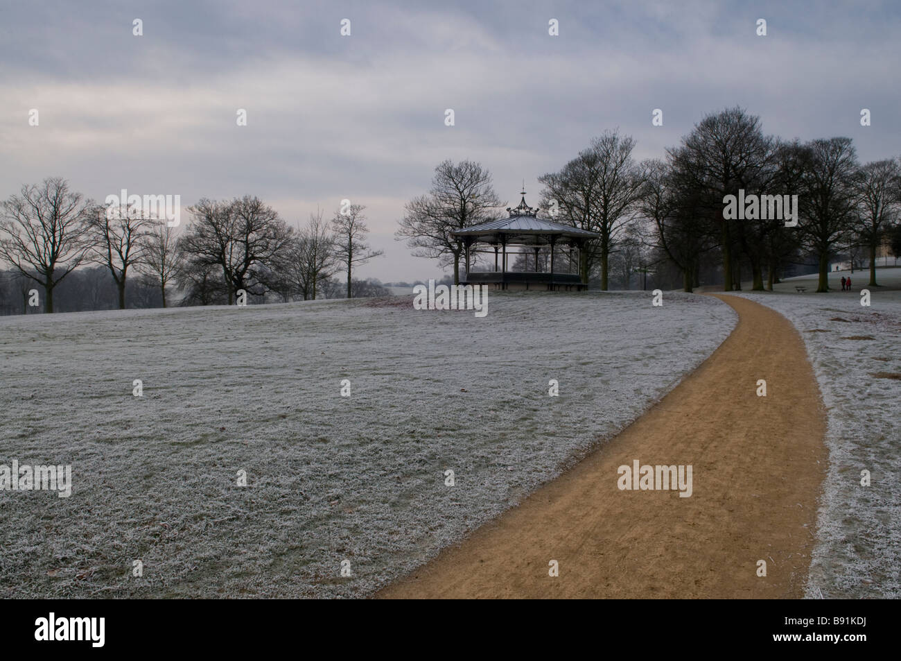 A frosty path leading to the Victorian bandstand in Roundhay Park, Leeds, England in the winter Stock Photo