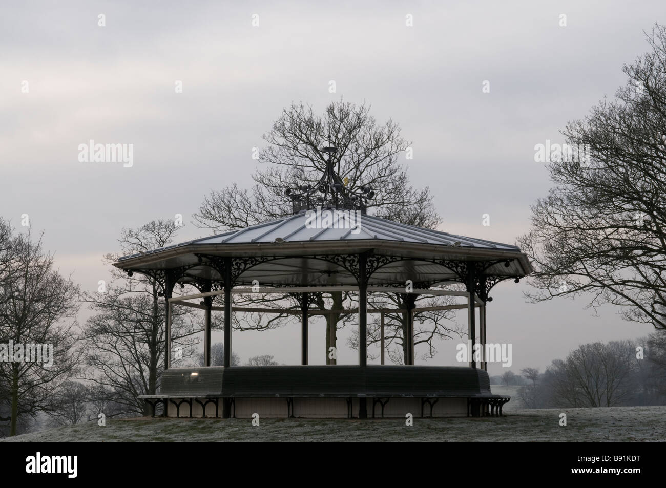 The Victorian bandstand in Roundhay Park, Leeds, England, covered in frost in the winter Stock Photo