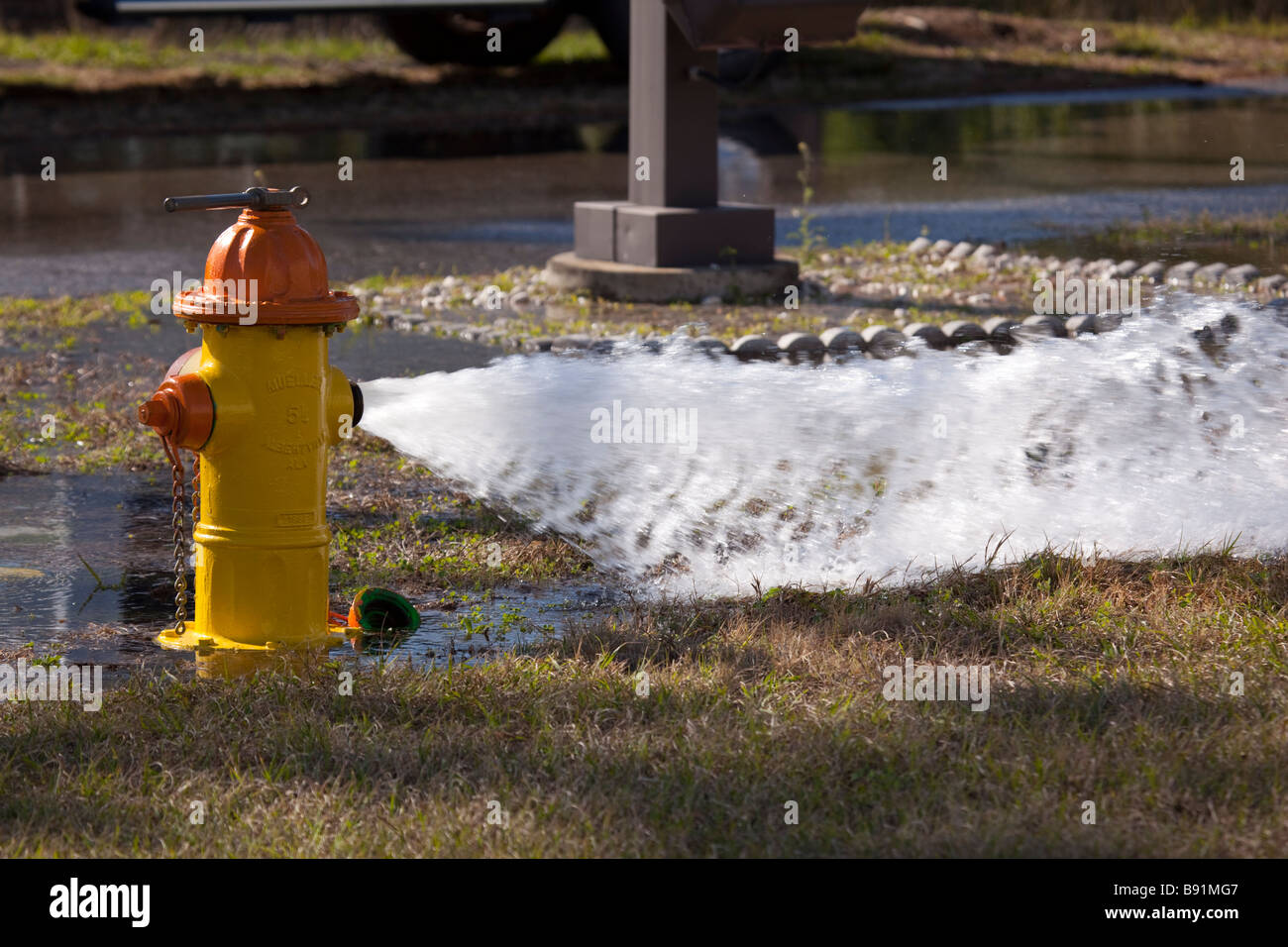 Water gushing out of an open fire hydrant - Stock Image