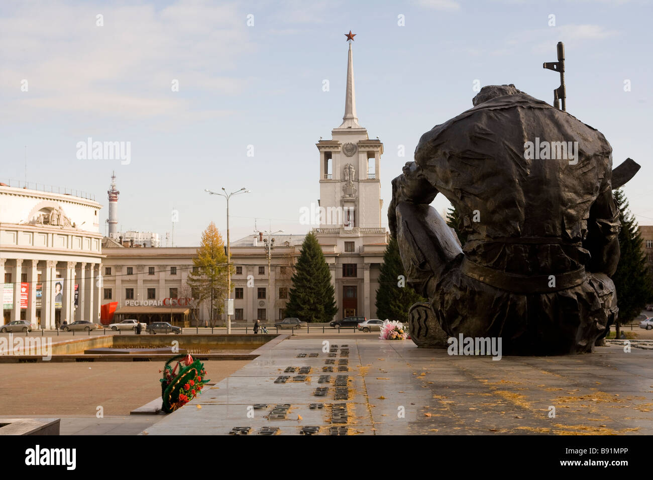 Russia Chechnya war memorial and former KGB headquarters in the background, Ekaterinburg, Russia - Stock Image