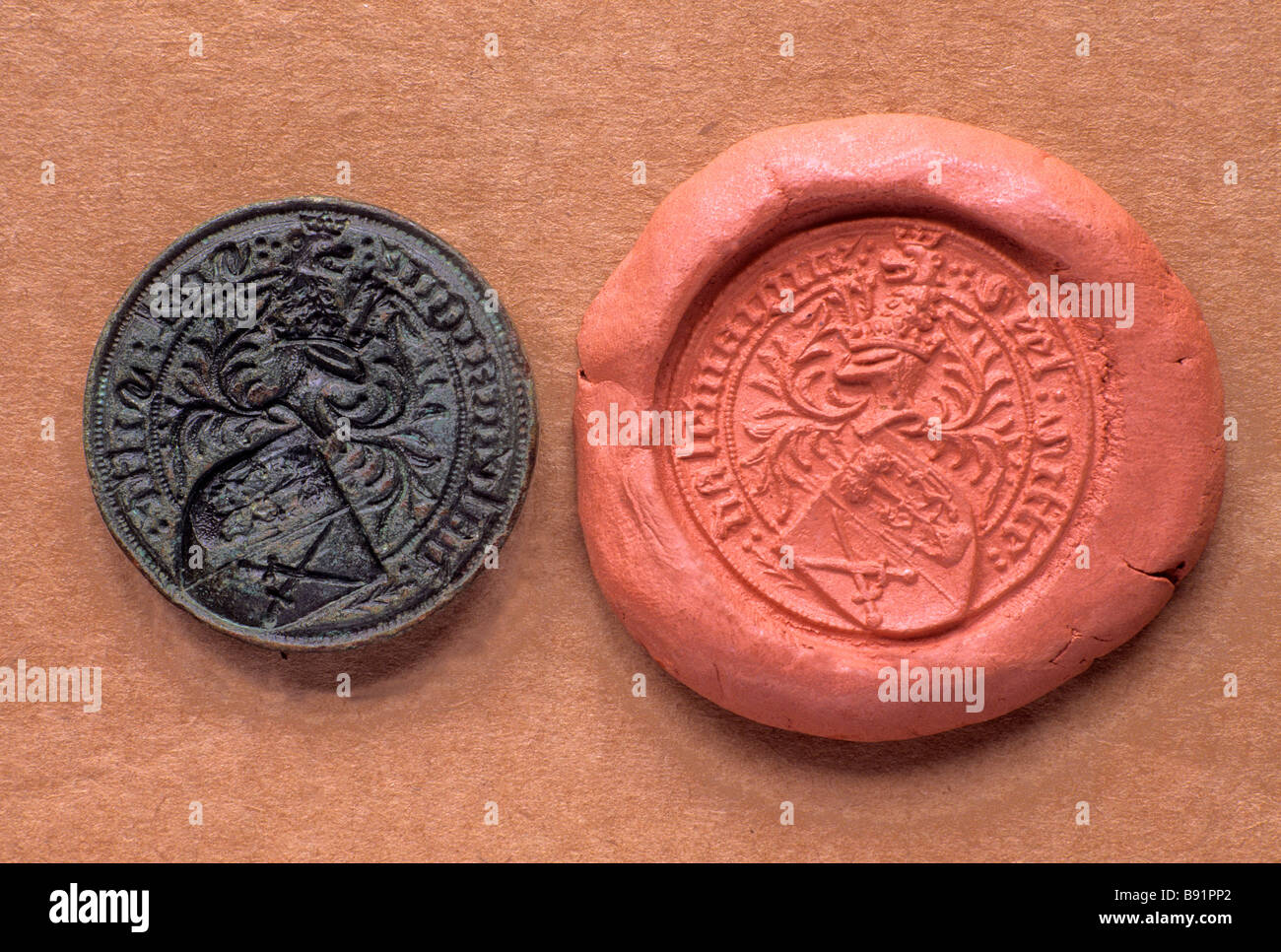 Medieval Seal Matrix and Wax Impression 15th century artefact metal detecting find copper brass England UK - Stock Image