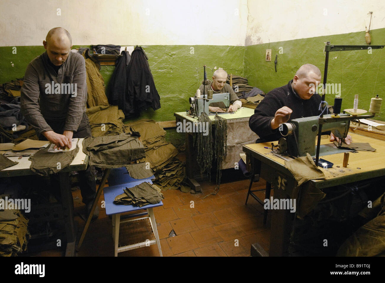 Manufacturing mittens at Penitentiary No 5 for convicts serving life sentences on Ognenny Fiery Island in the Vologda - Stock Image