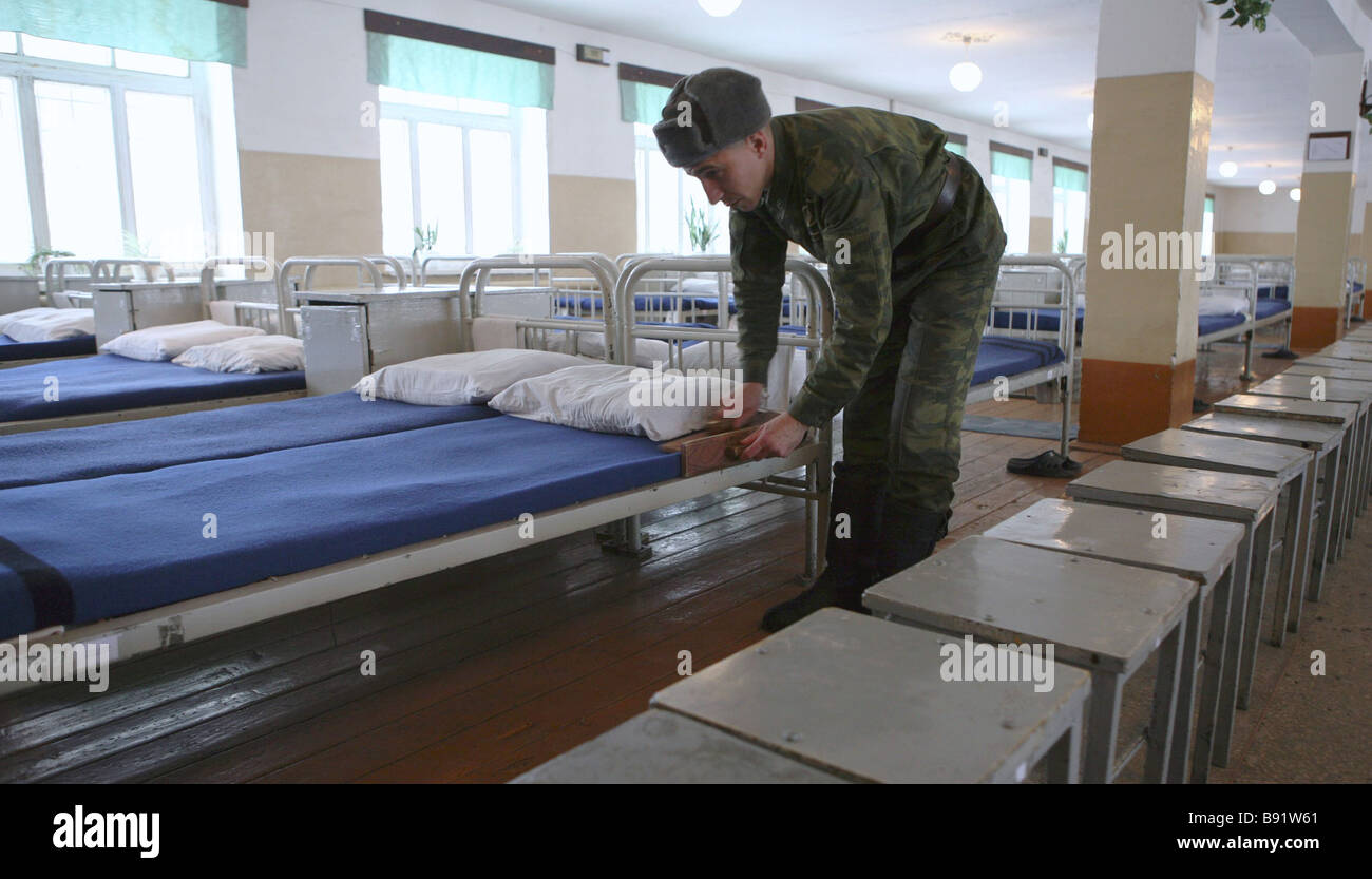 A serviceman making his bed Daily life in the Independent Military Correctional Battalion of the Siberian Military - Stock Image