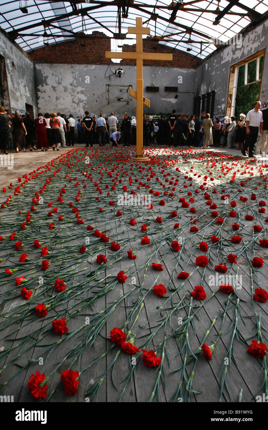 A memorial service held in Beslan for the 333 victims of the Beslan school hostage taking on September 1 2004 - Stock Image