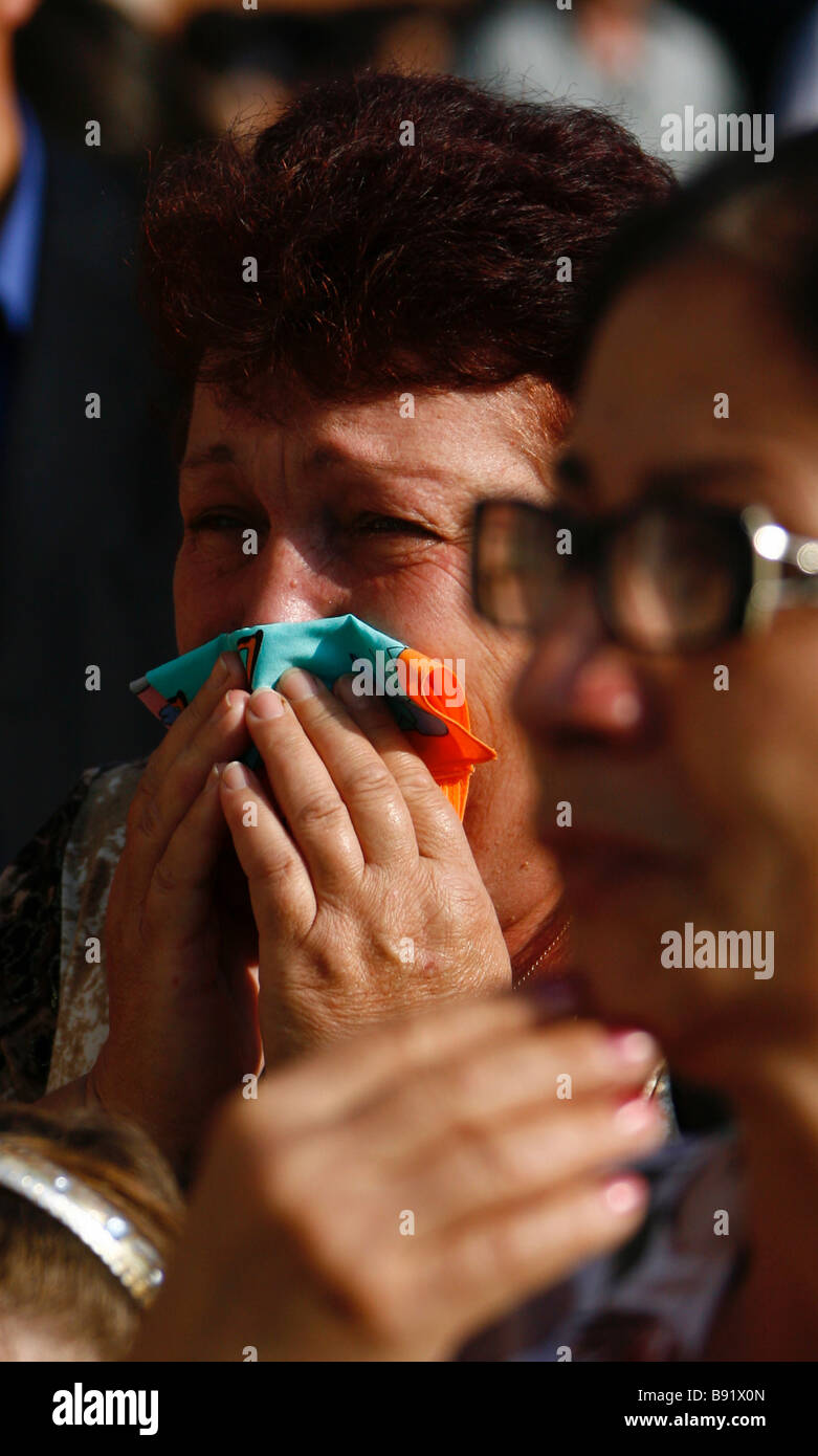 People in Beslan mourning the 333 victims of the Beslan school hostage taking on September 1 2004 - Stock Image
