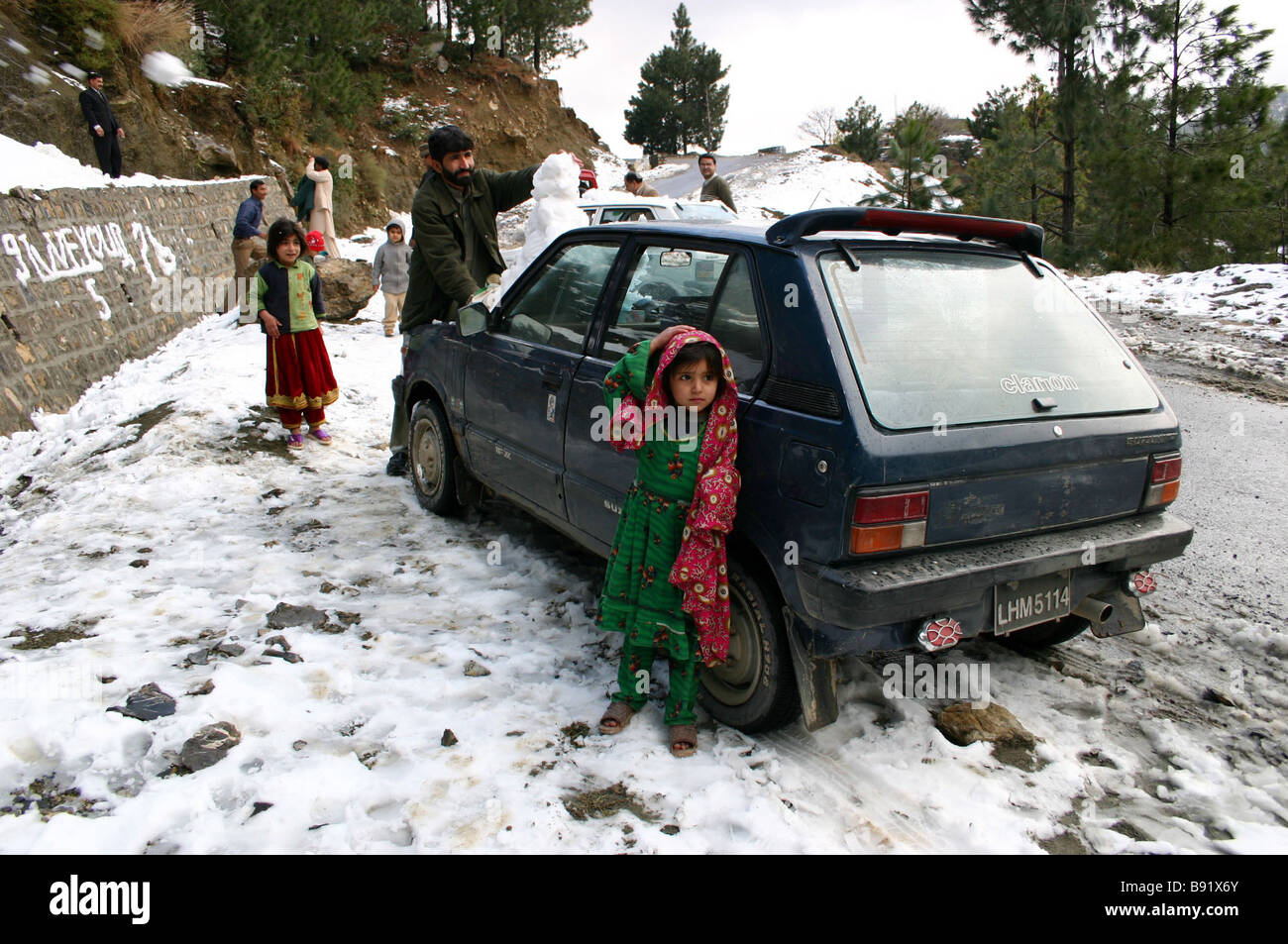First snow has fallen on the Margala Hills near Islamabad Pakistan in the past six years Many city dwellers drive - Stock Image