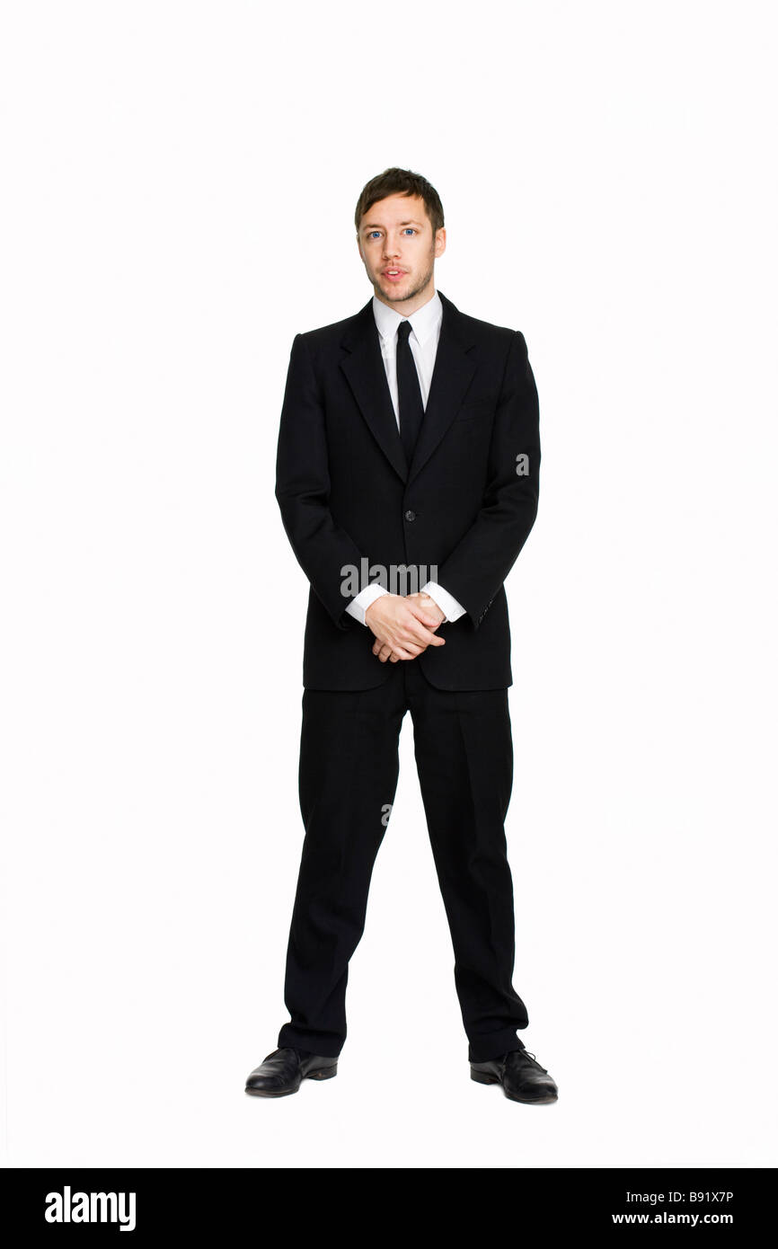 A man in a suit against white background Sweden - Stock Image