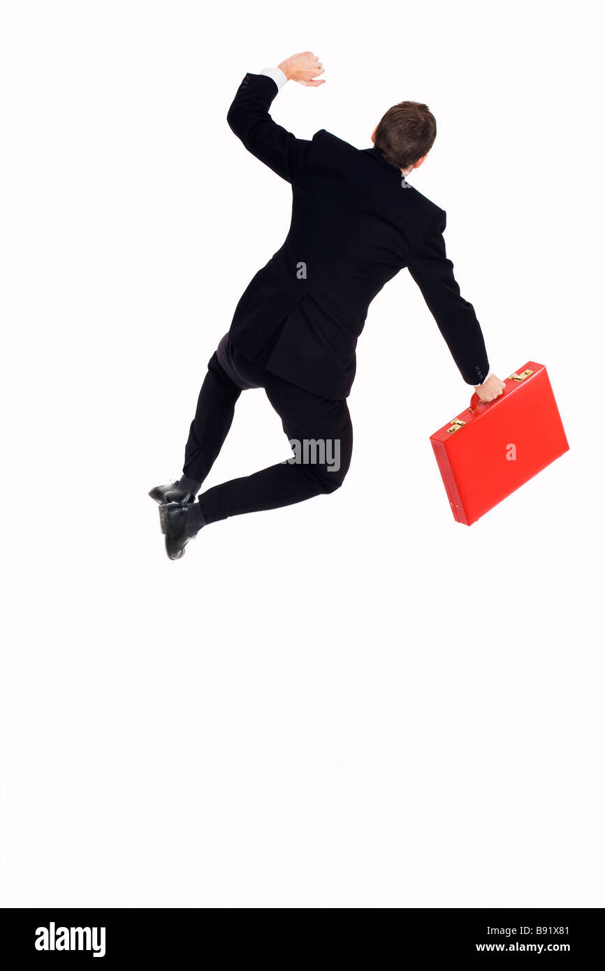A man in a suit holding a red briefcase Sweden - Stock Image