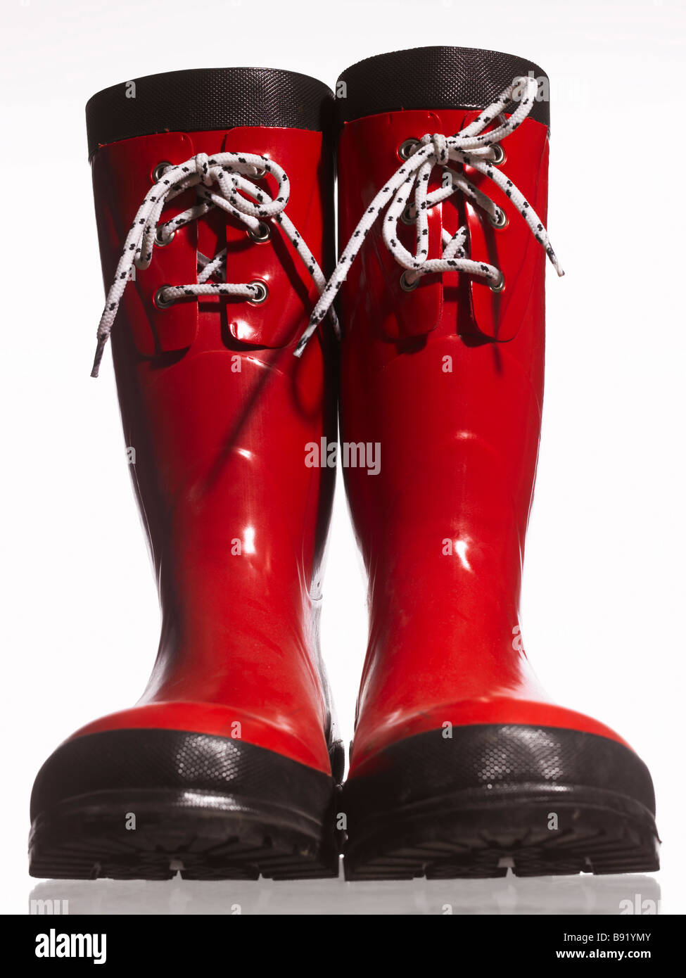 Red rubber boots. - Stock Image