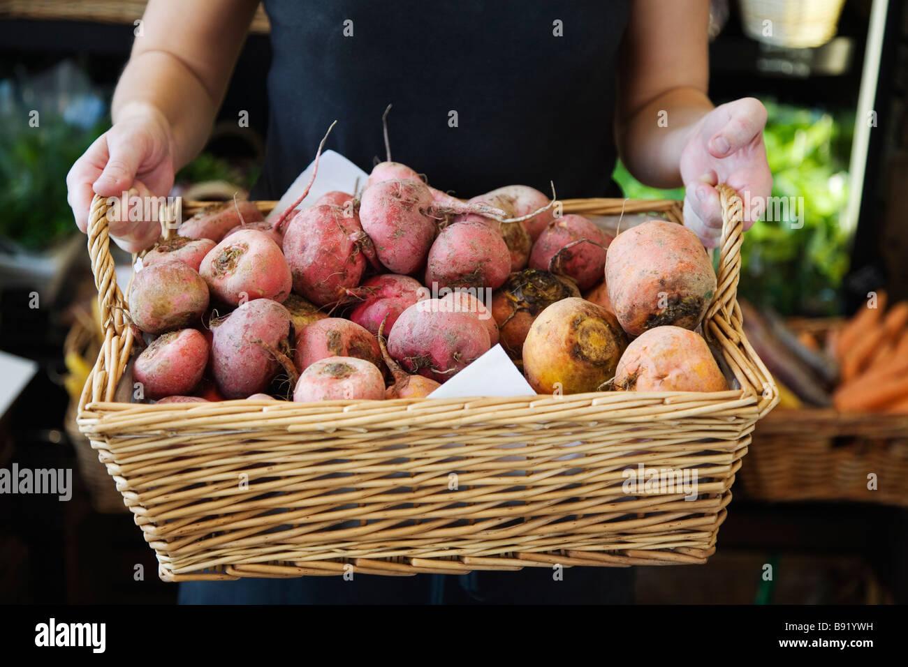 Root vegetables in a basket Sweden. - Stock Image