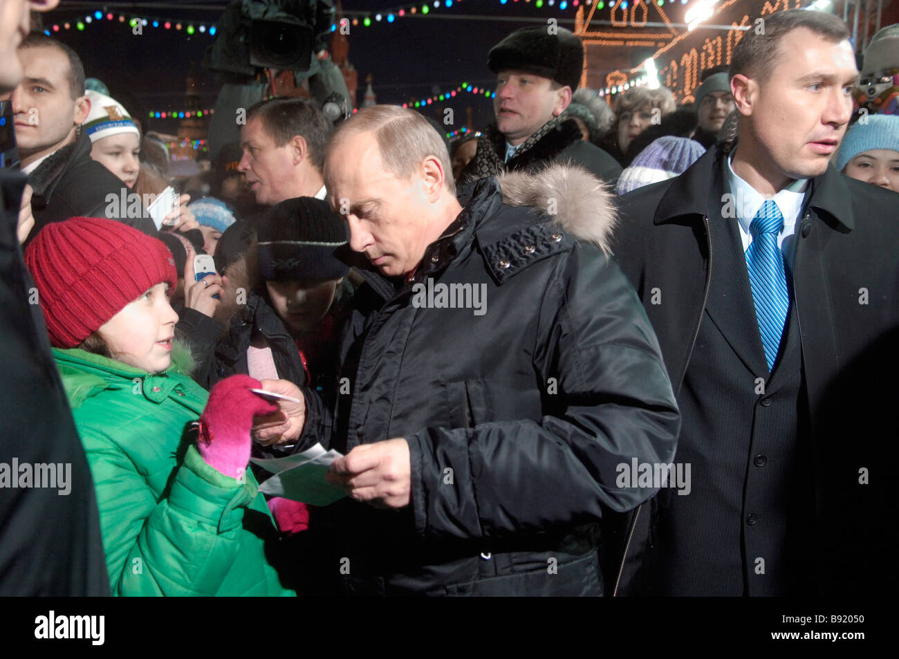 Russian President Vladimir Putin visits the Red Square skating rink next to the Kremlin - Stock Image