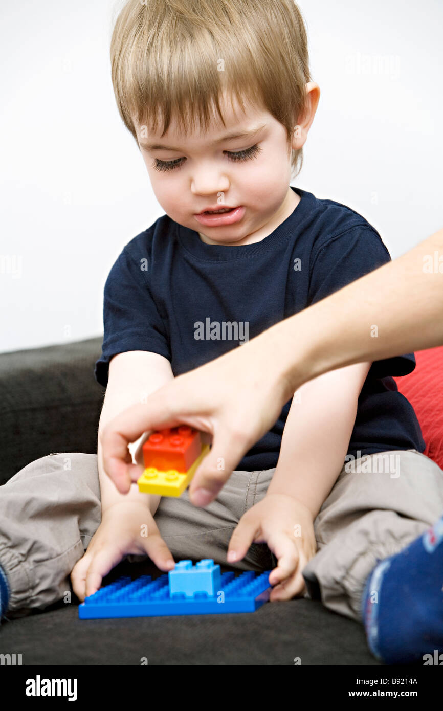 A little boy playing with Lego Sweden. - Stock Image