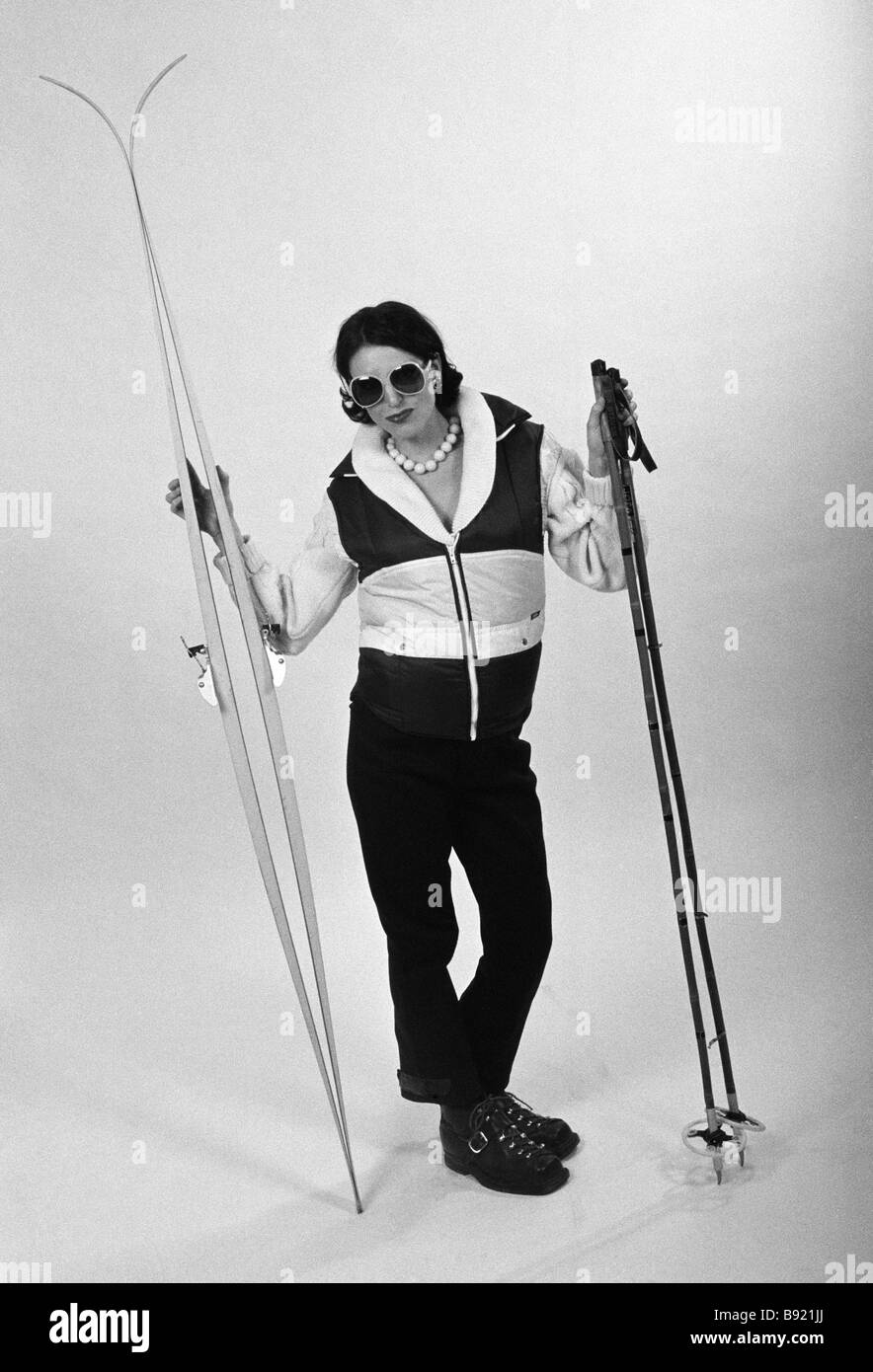 A woman with skis and ski poles Sweden. - Stock Image