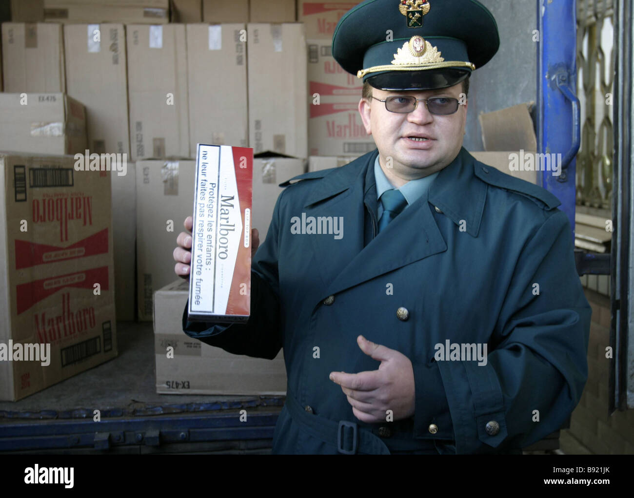 Pavel Tkachenko chief of the Contraband Section at Central Operations Customs House demonstrating a block of counterfeit - Stock Image