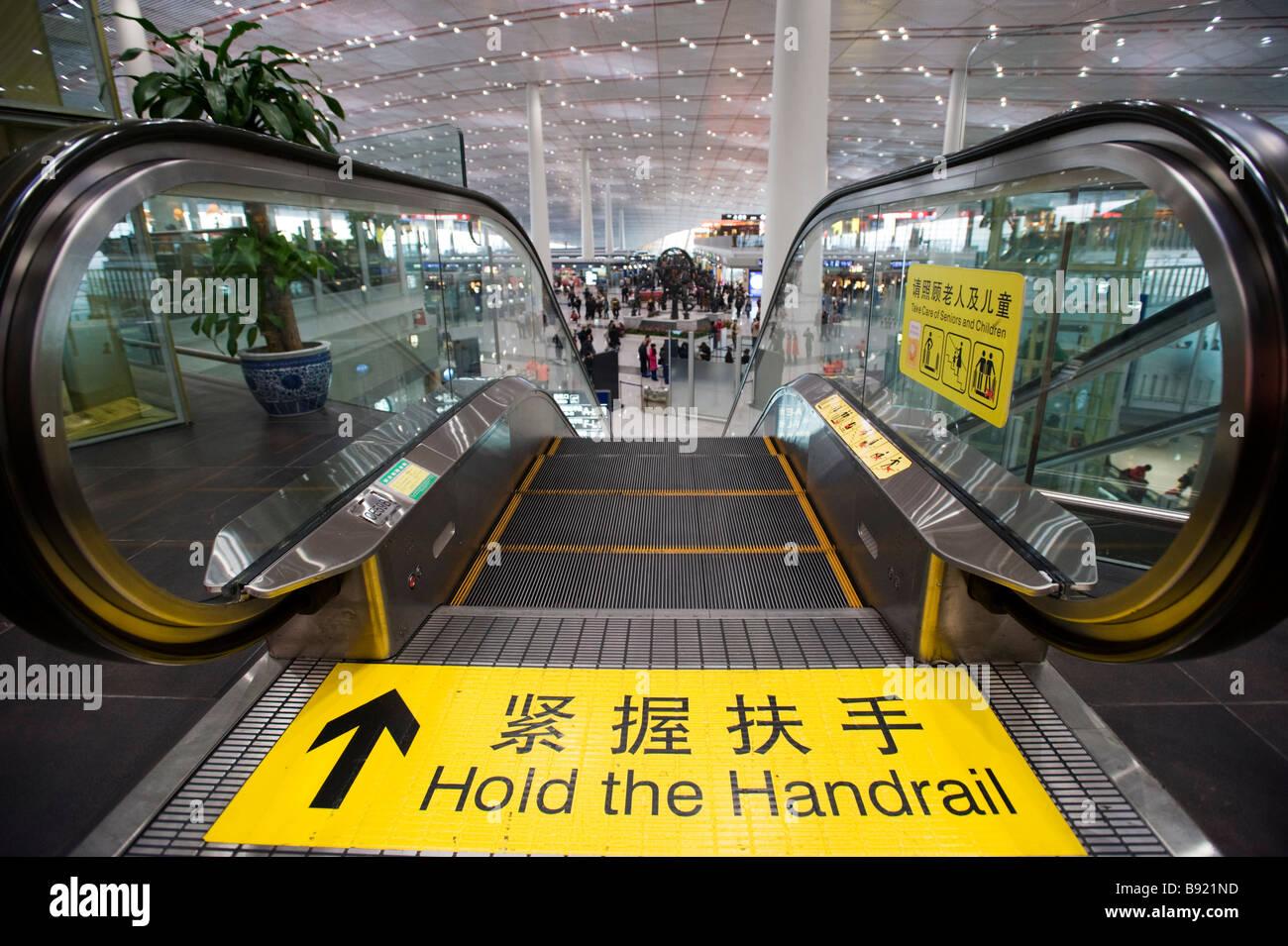 Detail of escalator at new Terminal 3 at Beijing Airport China - Stock Image