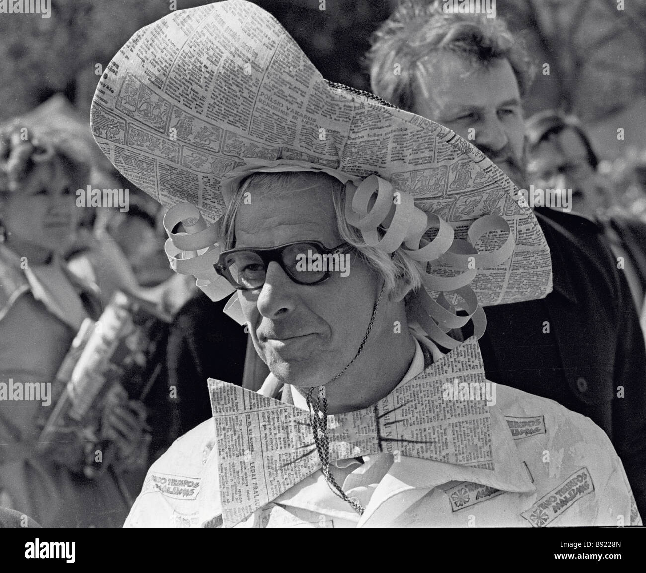 Journalist in a unique hat made of newspaper during Press Day - Stock Image