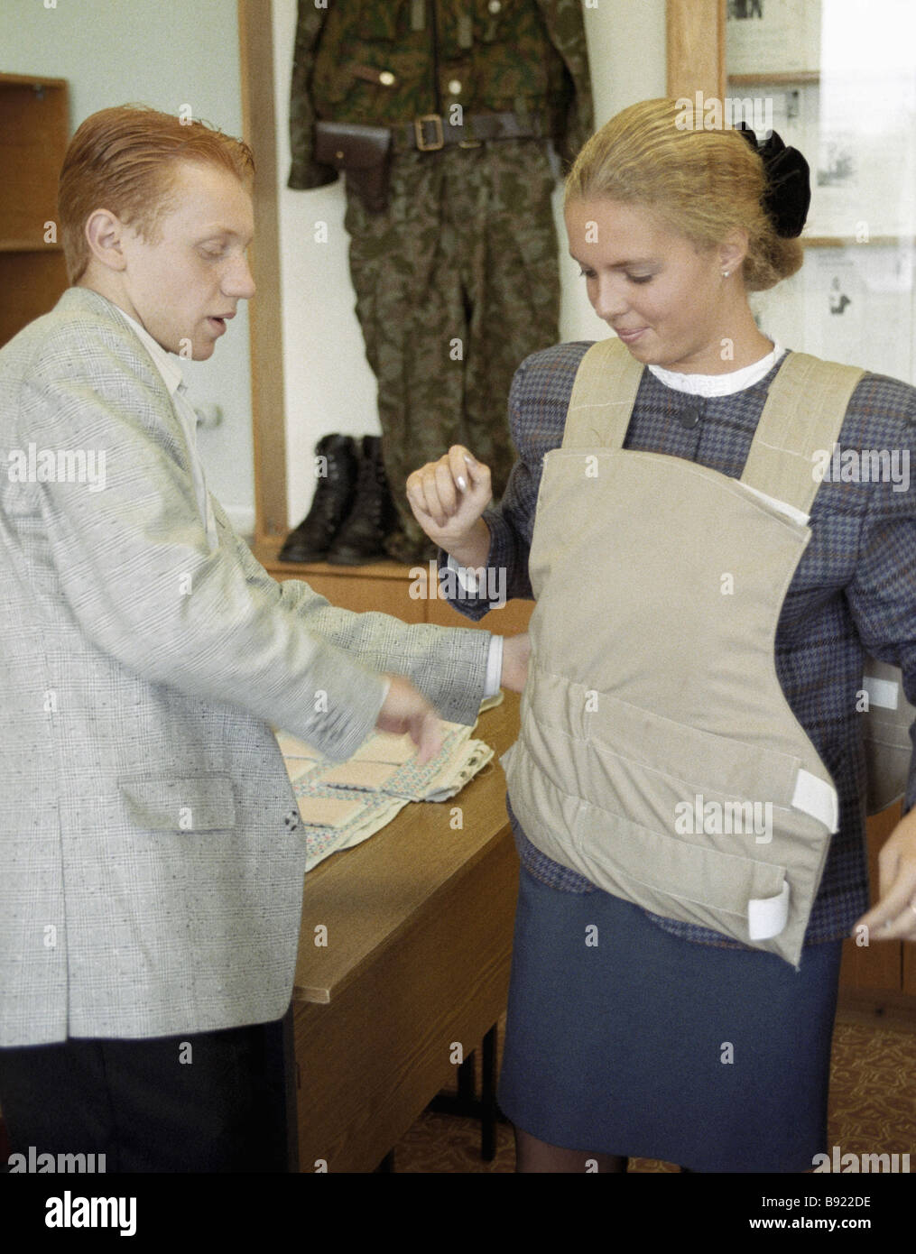 Tax police officer tries on a bullet proof jacket - Stock Image