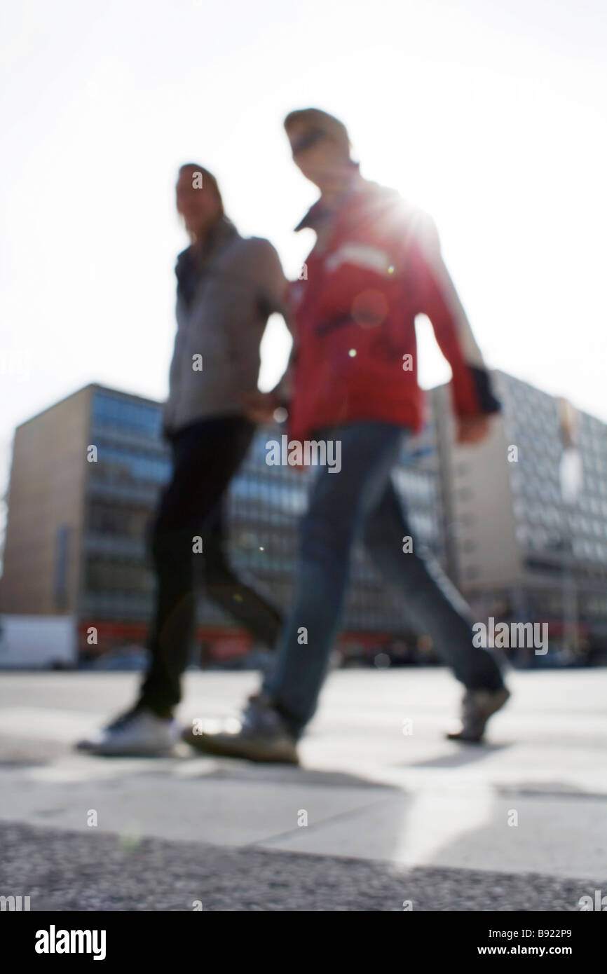 Two persons walking in the city, Stockholm, Sweden. - Stock Image