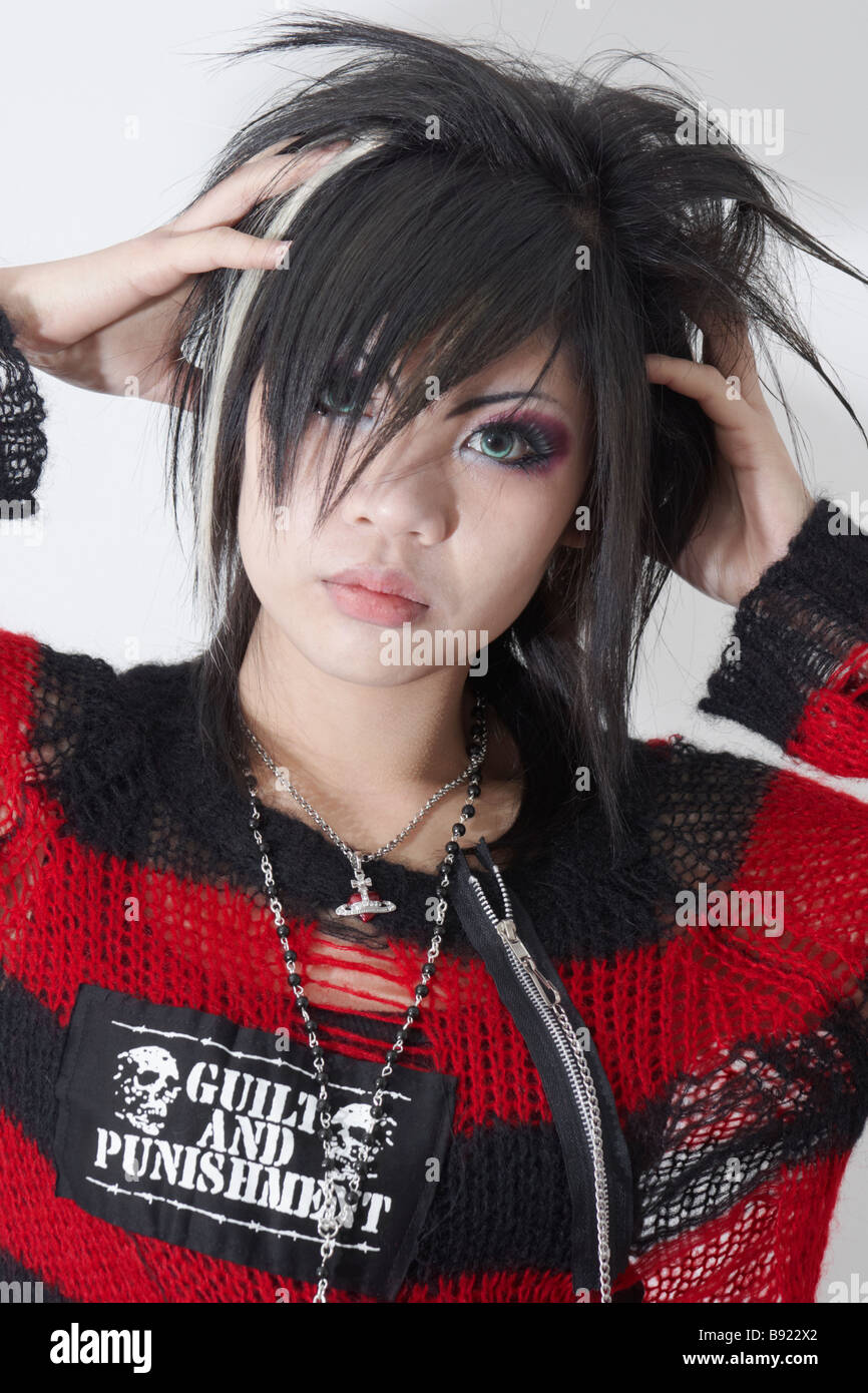 Young japanese woman in style of visual kei with black red