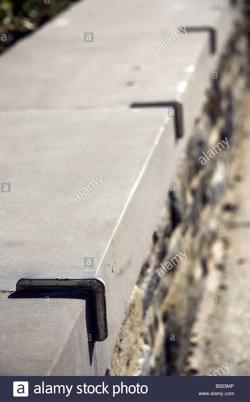 Skateboard deterrent fixings on a low wall, UK. - Stock Image